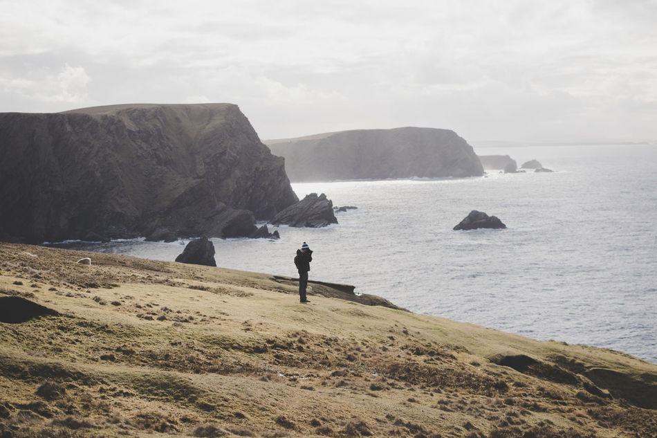 Hermaness, Unst Island Adults Only Adventure Atlantic Ocean Beauty In Nature Cliff Cloud - Sky Coastline Hiking Horizon Over Water Men Nature Outdoors Photographer Real People Rock - Object Scenics Travel Water