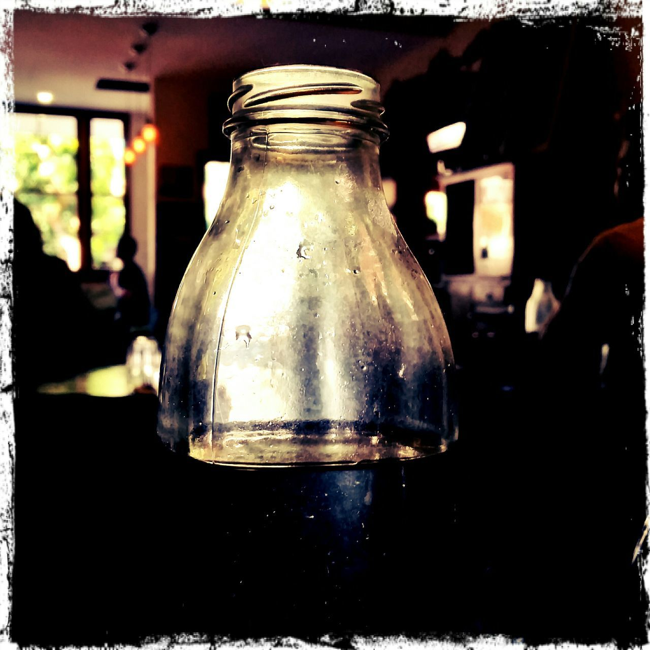 jar, table, bottle, focus on foreground, indoors, close-up, no people, day