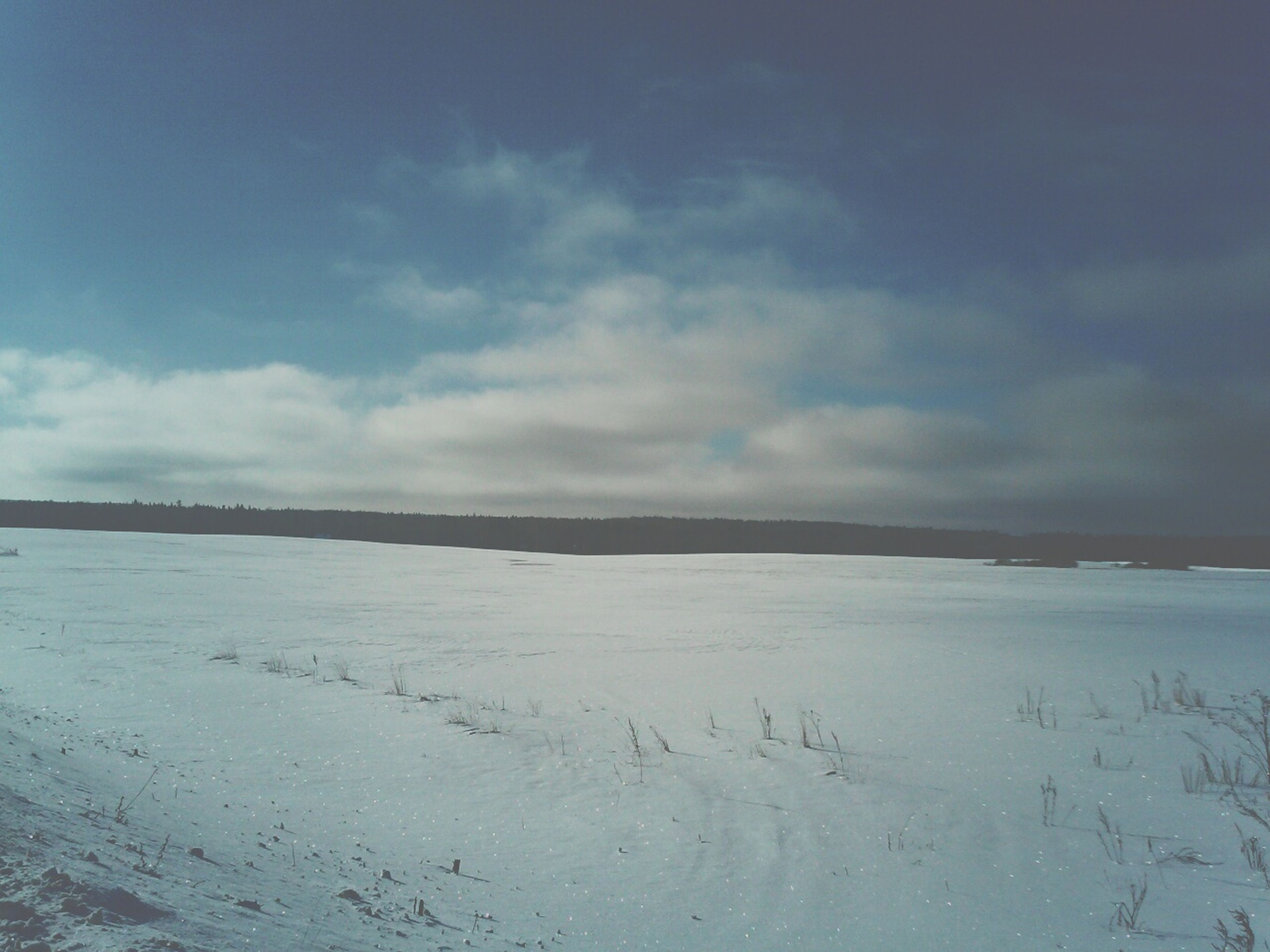 tranquil scene, tranquility, sky, scenics, snow, cold temperature, winter, beauty in nature, nature, landscape, weather, cloud - sky, beach, water, non-urban scene, sand, idyllic, season, cloud, day