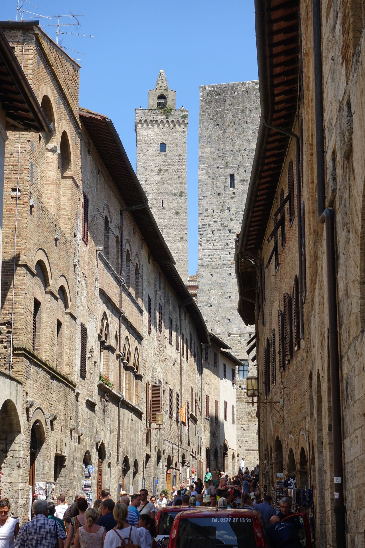 in the Roads Architecture Building Exterior Built Structure Clear Sky Etruscan Civilization Historic Centre Manhatten Skyline Medival City Outdoors San Gimignano Torre Toscana ıtaly Travel Destinations