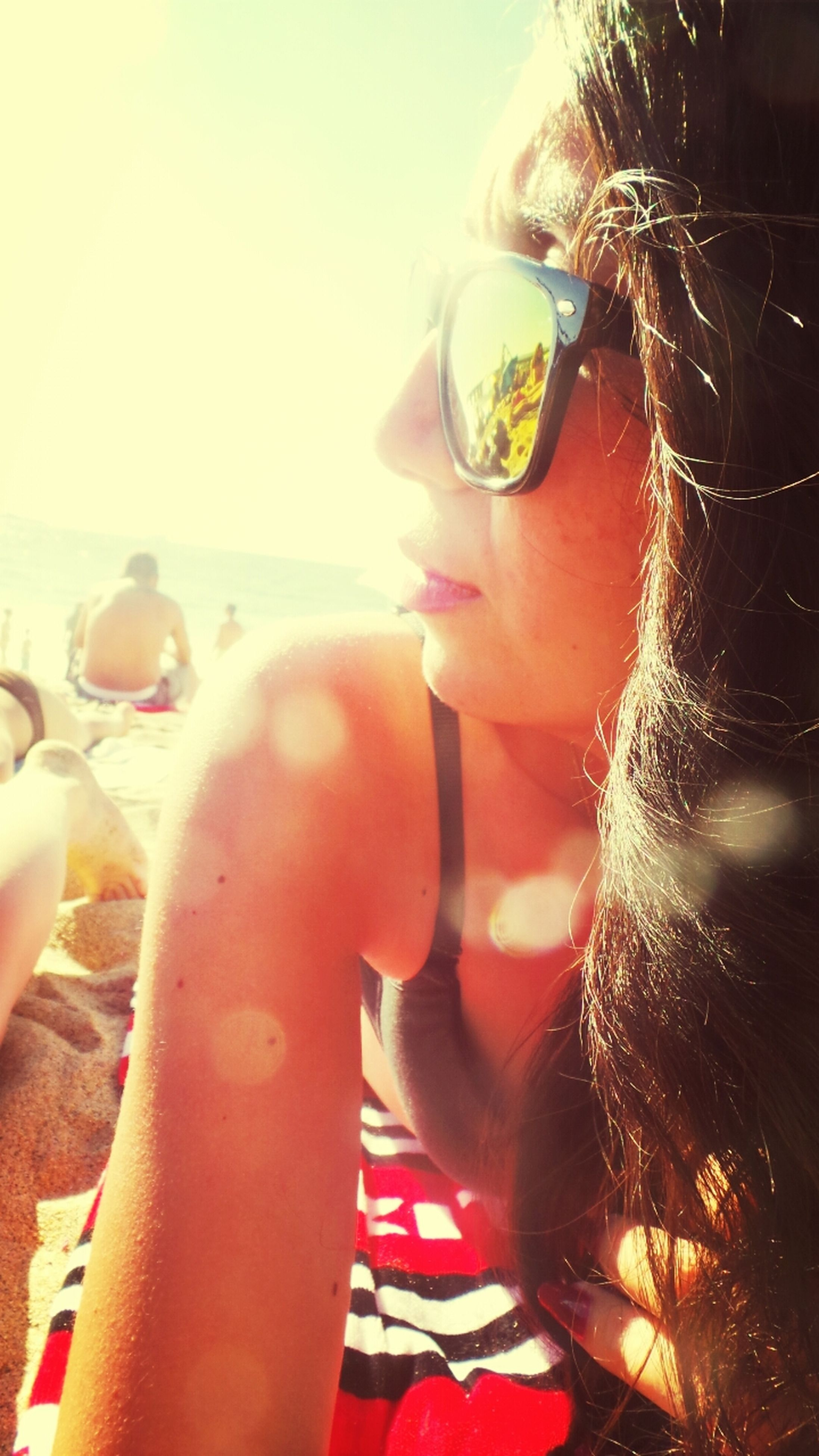 lifestyles, leisure activity, headshot, sunglasses, sunlight, holding, person, young adult, close-up, young women, sky, sun, lens flare, part of, outdoors, drink, focus on foreground