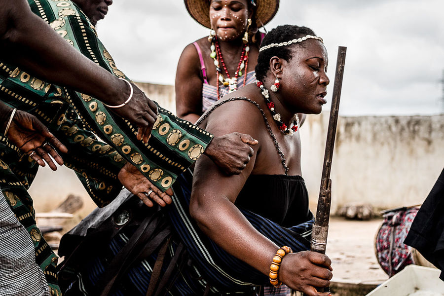 Adept in trance celebrating Wourou, the divinity of iron (known as Ogun) in Gorobani village | Parakou, North, Benin. Adept Africa Benin Celebrating Divinity Documentary Photography Gun Iron North Outdoors Portrait Real People The Photojournalist - 2017 EyeEm Awards Trance Village Young Women