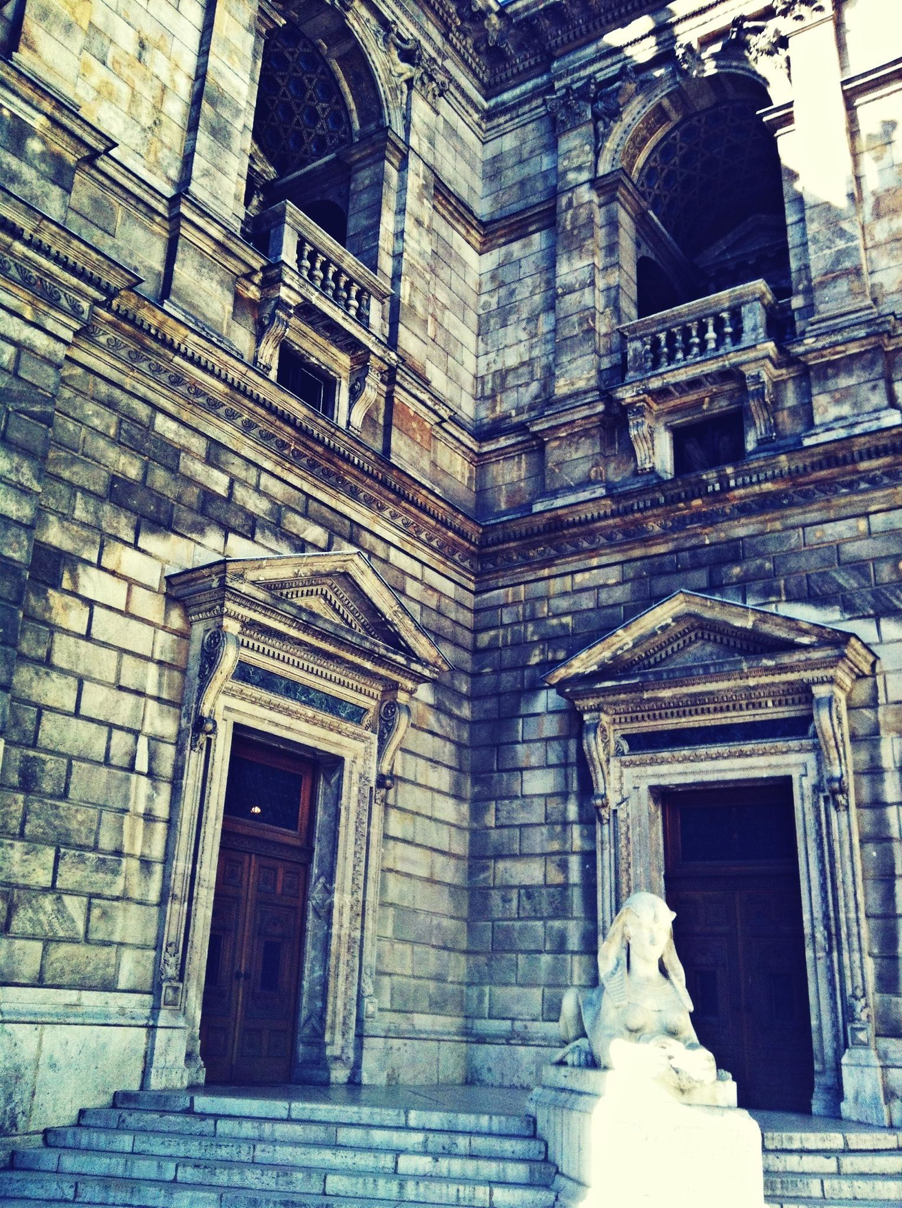 architecture, building exterior, built structure, low angle view, window, old, statue, building, history, facade, sculpture, arch, art and craft, human representation, outdoors, day, no people, art, entrance, historic