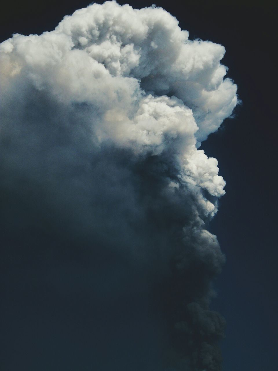 Cloud Of Volcanic Ash Against Dark Sky