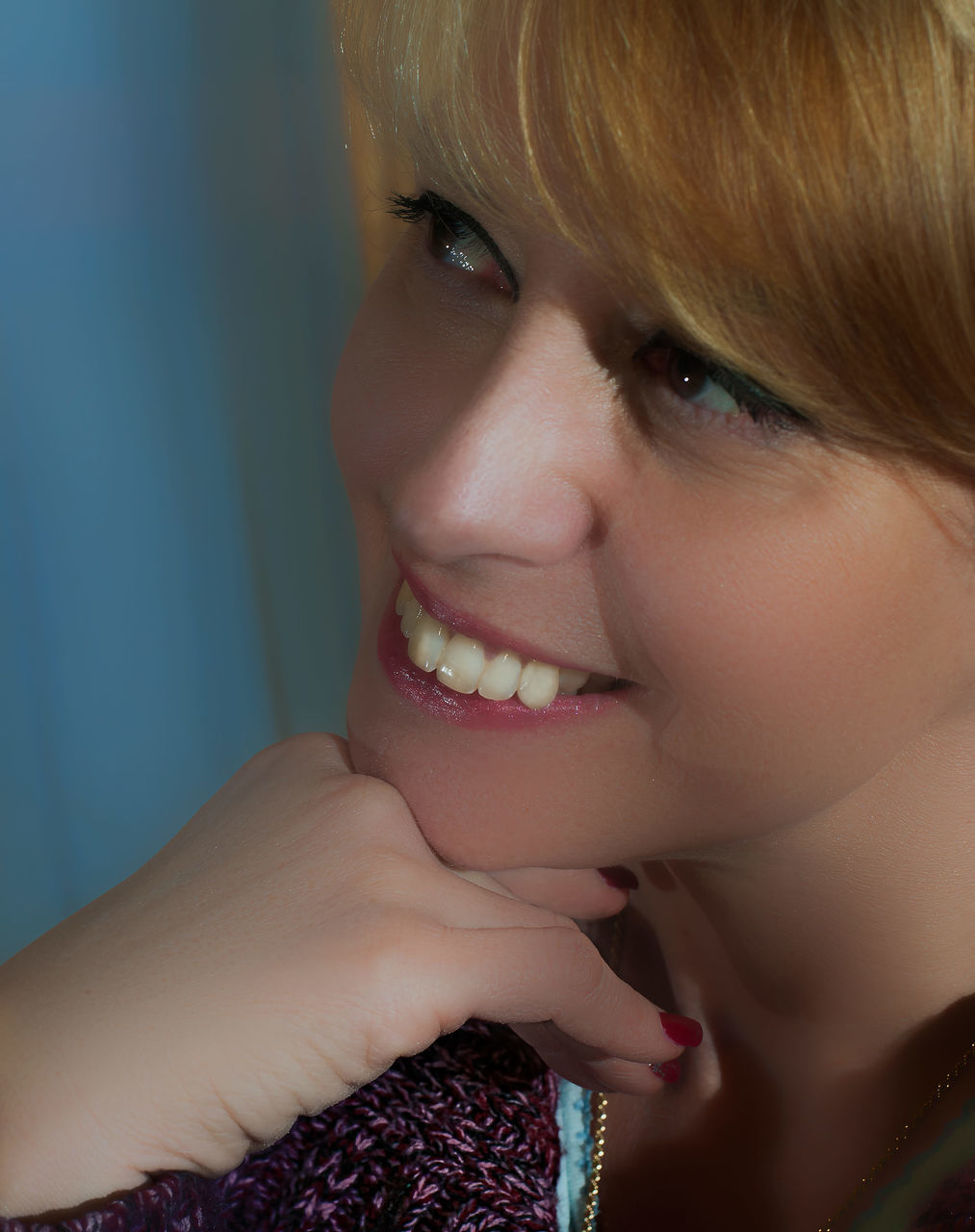 Close-Up Of Thoughtful Smiling Young Woman