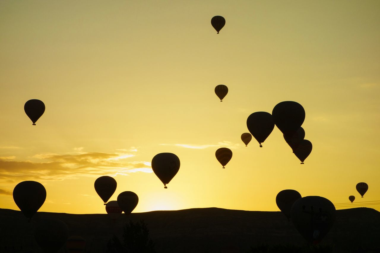 Silhouette Hot Air Balloons In Mid-Air At Cappadocia During Sunset
