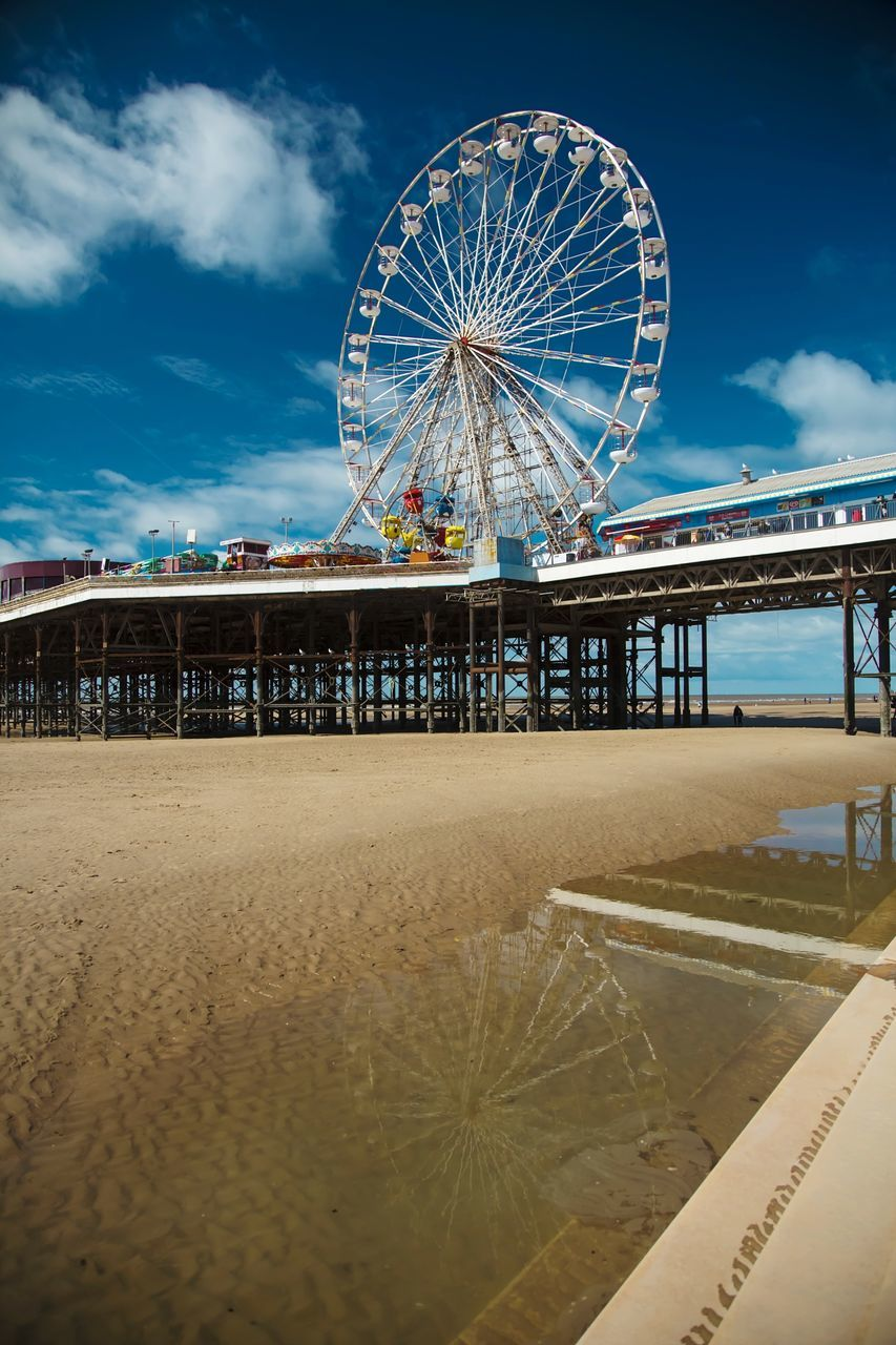 amusement park, ferris wheel, arts culture and entertainment, amusement park ride, sky, beach, sand, big wheel, leisure activity, outdoors, day, no people, nature, carousel