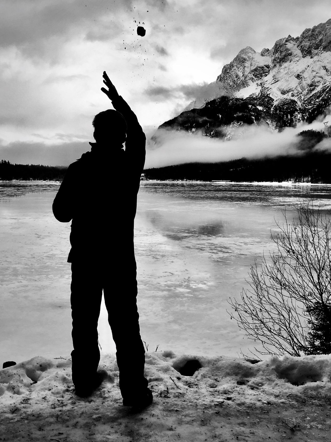 Winter wonderland... Real People Nature Water Sky Standing Mountain Beauty In Nature Men Outdoors One Person Silhouette Scenics Beach Full Length Day Ice Cold Temperature Snow ❄ Minimalism White IPhoneography Wintertime Winter Wonderland Blackandwhite Photography Blackandwhitephotography