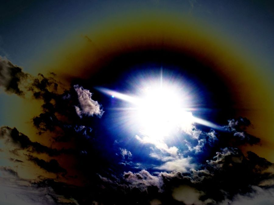Sunbeam Sunlight Sun Low Angle View Blue Nature Beauty In Nature No People Multi Colored Sky Luminosity Day Gods Eye