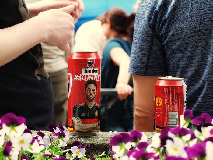 """beer cans """"Red Devil"""" (Belgian national football team), Brussels Real People Flower Togetherness Boys Day Beer Cans Red Devils Football Soccer Belgium Team Streetphotography Brussels Fragility Close-up Chance Human Hand Freshness People Close Up Jupiler"""