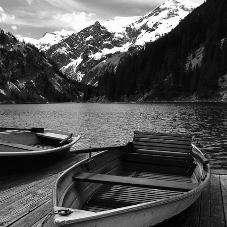 boats at vilsalpsee, tannheimer tal Life Light Tannheimer Tal Tirol  Travel Alps Beauty In Nature Black And White Clouds Lake Moored Mountain Mountain Range Nature Nautical Vessel Outdoors Scenics Shadow Sky Snowcapped Mountain Spring Tranquil Scene Transportation Vilsalpsee Water