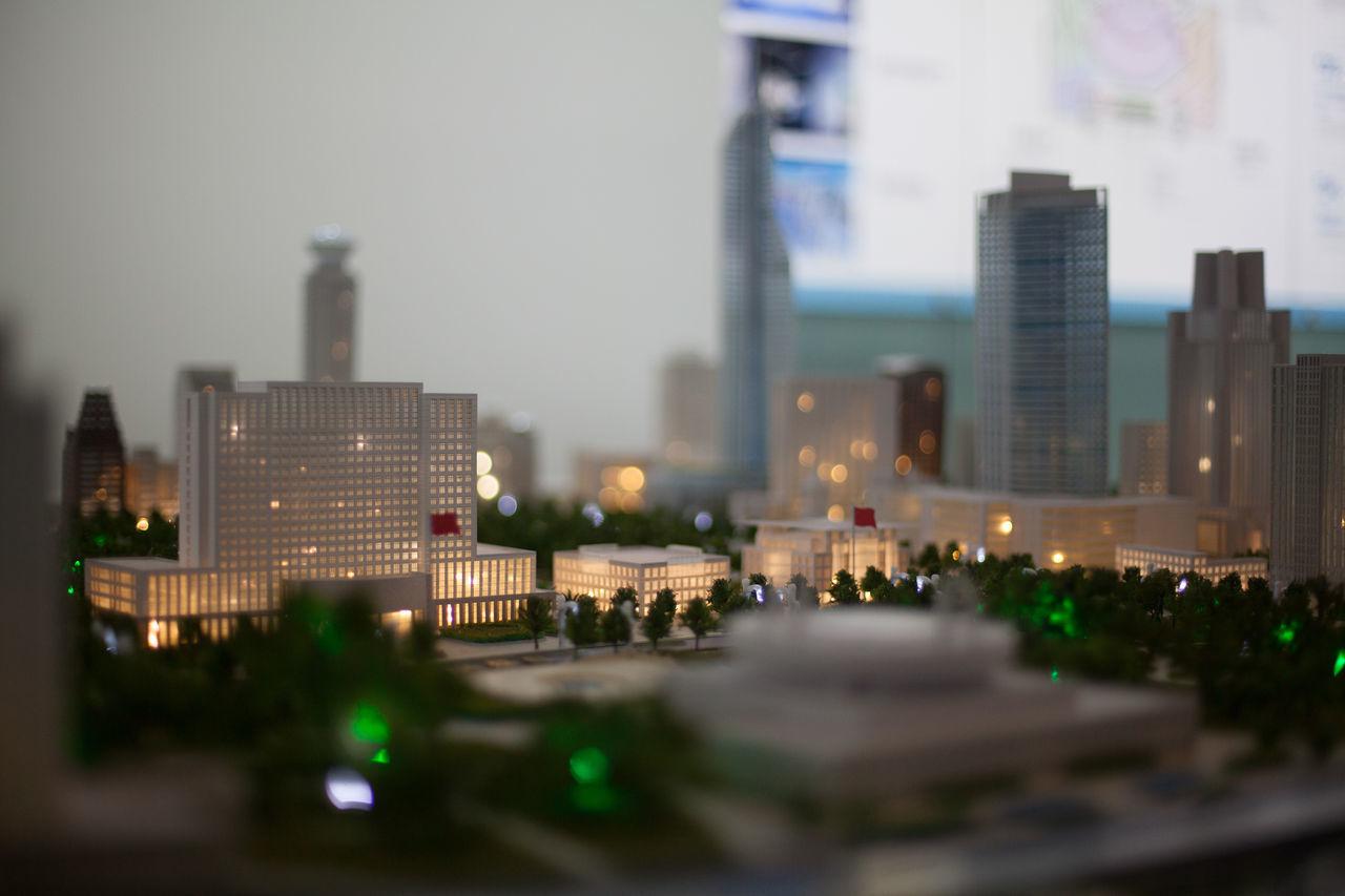 architecture, city, skyscraper, building exterior, built structure, cityscape, travel destinations, modern, no people, illuminated, tilt-shift, outdoors, sky, urban skyline, day