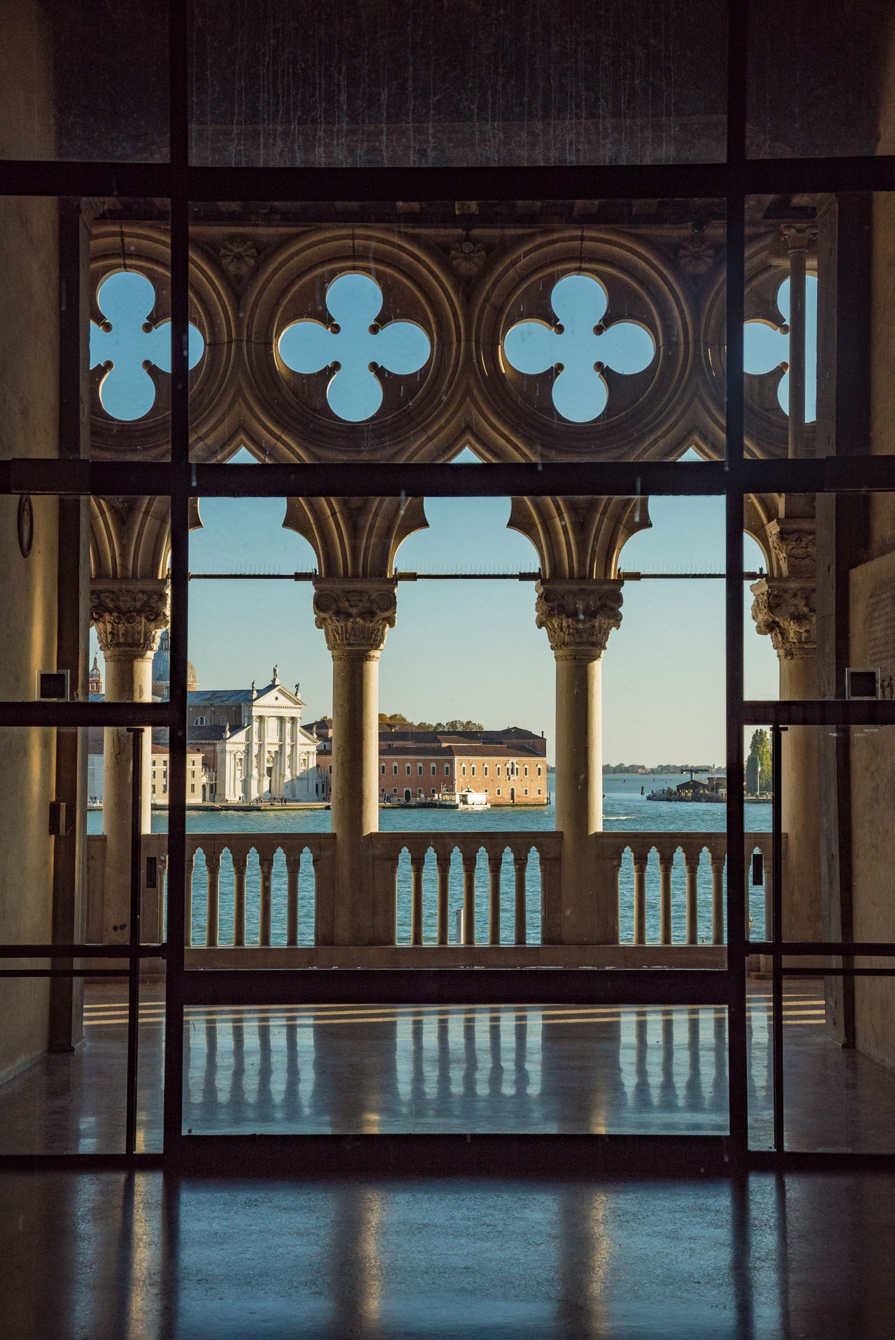 Architectural Column Architecture Building Exterior Built Structure City Day Doge's Palace Marble No People Outdoors Patriotism Place Of Worship Politics Quatrefoil Reflection Travel Travel Destinations Venice Vista Water Window