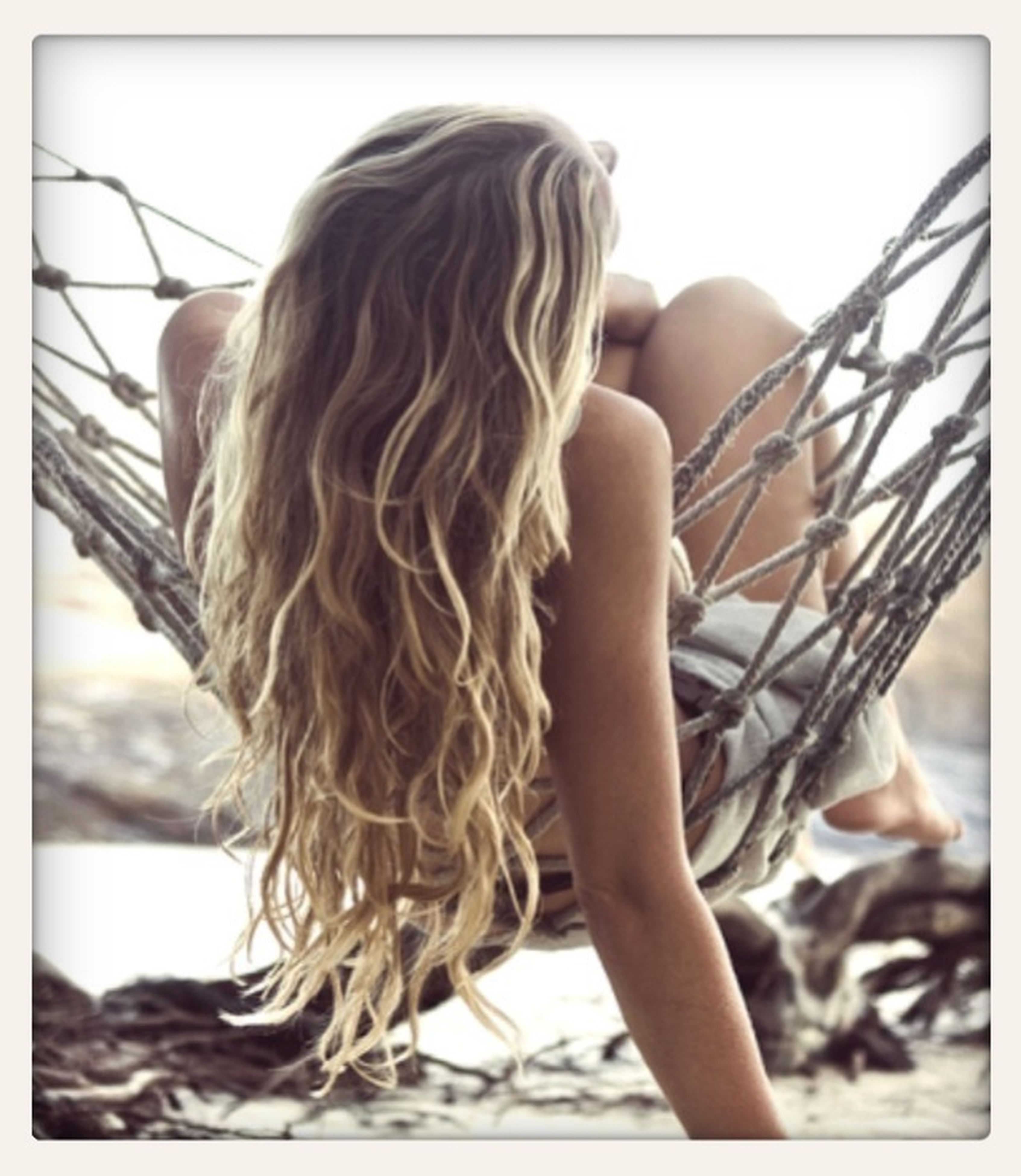 transfer print, lifestyles, long hair, auto post production filter, young women, leisure activity, young adult, person, rear view, indoors, side view, focus on foreground, close-up, casual clothing, sitting, childhood, sunlight
