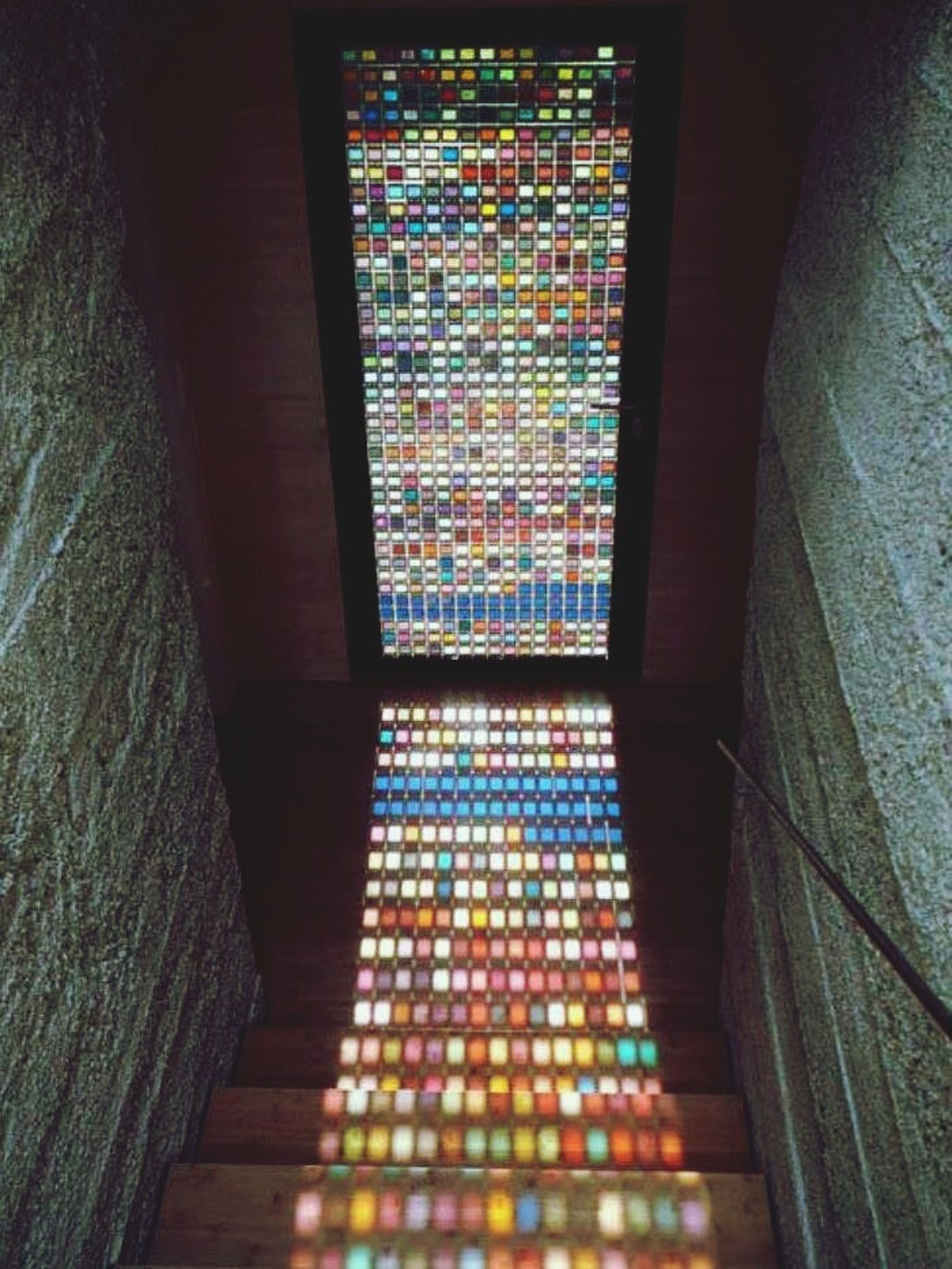 indoors, architecture, built structure, pattern, window, illuminated, steps, building, no people, design, railing, wall - building feature, building exterior, steps and staircases, staircase, high angle view, modern, wall, low angle view, multi colored