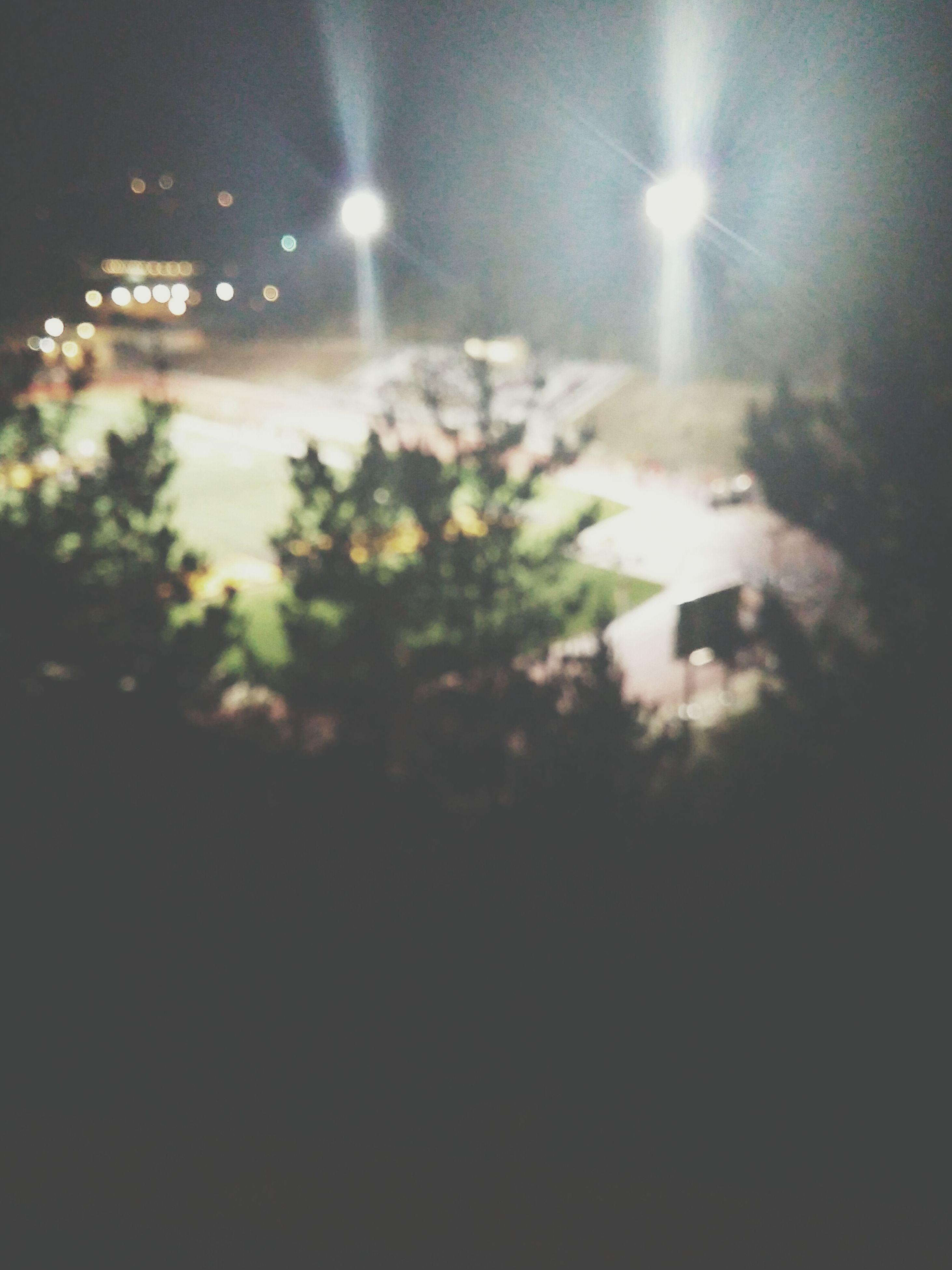 night, illuminated, lens flare, light - natural phenomenon, glowing, dark, sky, outdoors, street light, no people, nature, lighting equipment, defocused, tree, growth, tranquility, city, beauty in nature, sunlight, building exterior