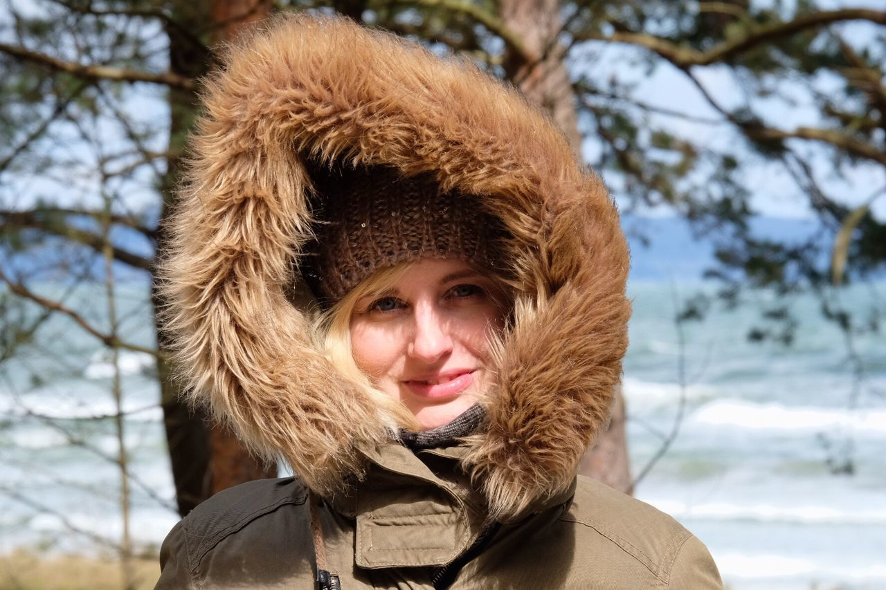 Portrait Of Smiling Woman Wearing Fur Hood