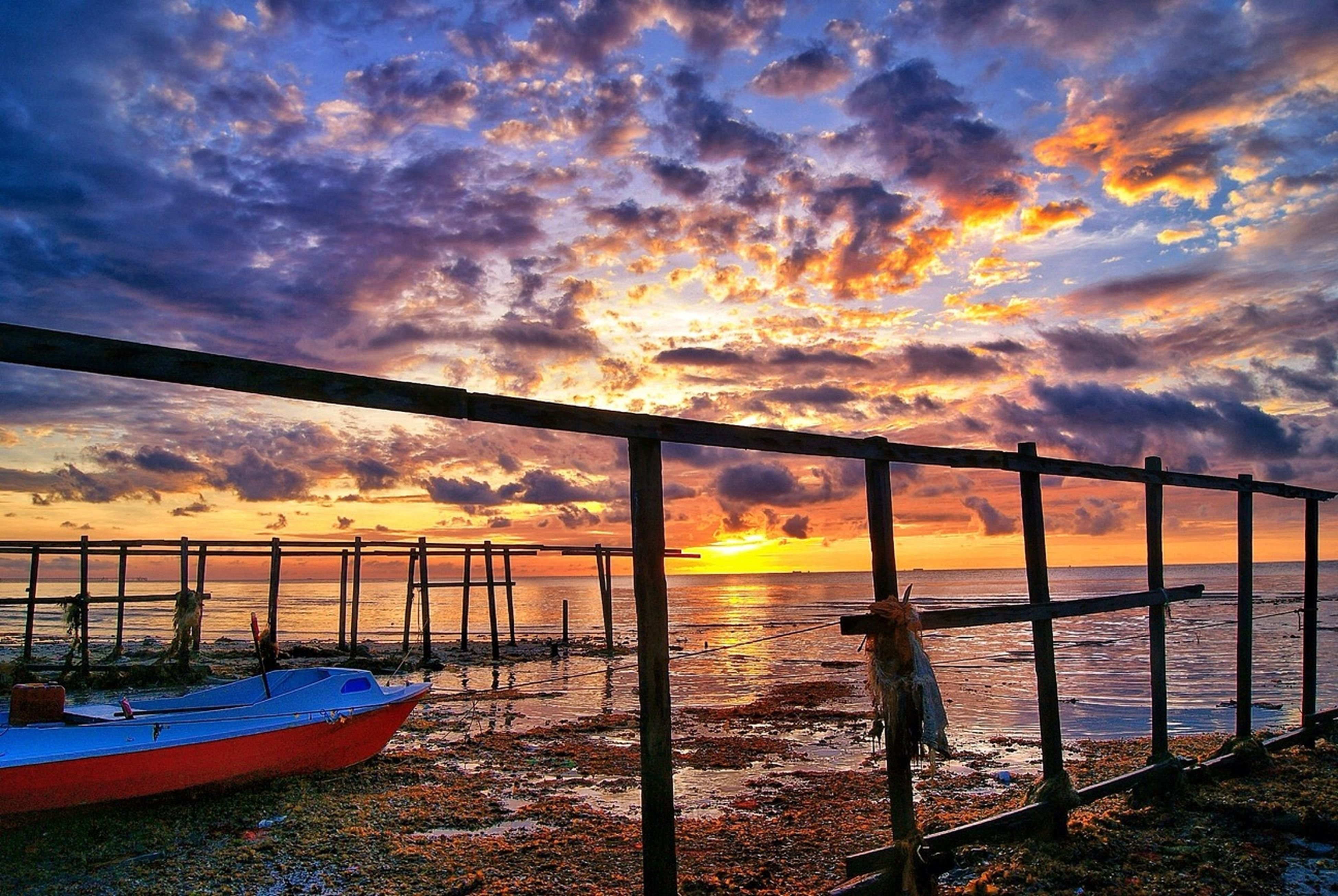 sky, sunset, water, cloud - sky, sea, railing, cloudy, scenics, beauty in nature, tranquility, nature, cloud, tranquil scene, orange color, weather, dramatic sky, horizon over water, idyllic, pier, reflection