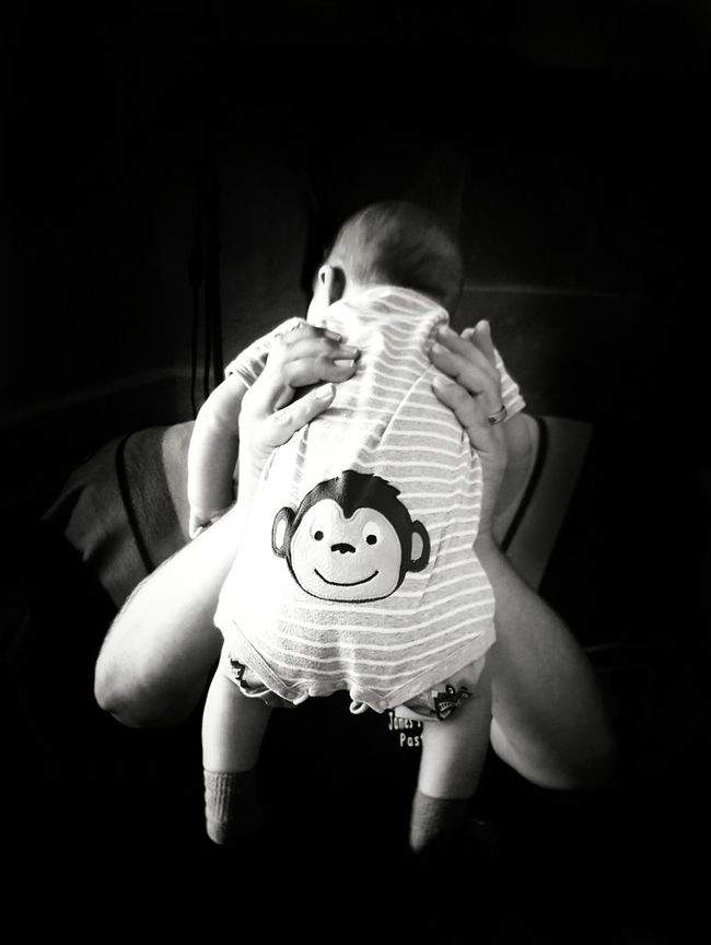 One Person Holding Sitting People Indoors  One Man Only Black Background Adult Human Body Part Day Monkey Baby Baby Boy Father Fatherhood Moments Affection Bonding Joy Joyful Baby Clothing Black And White Hands