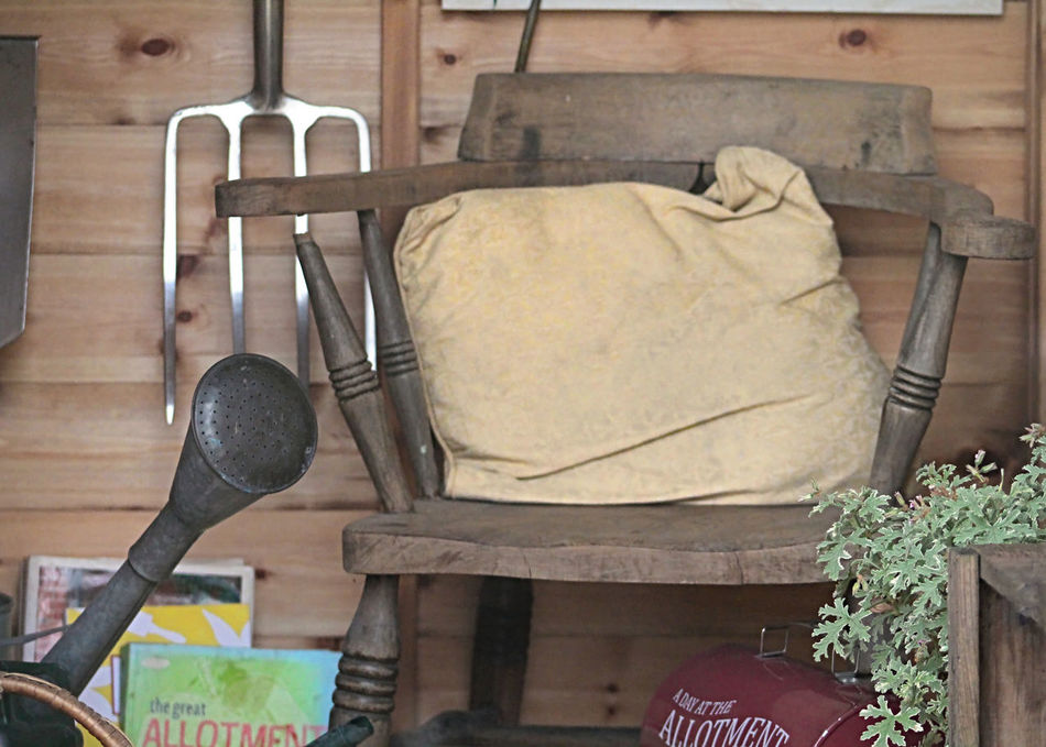 The Gardeners Chair Books Chair Close-up Cushion Fork Garden Garden Fork Garden Shed Gardening Gardening Tools Old Plant The Gardeners Chair Watering Can Wood - Material Wooden Chair Check This Out