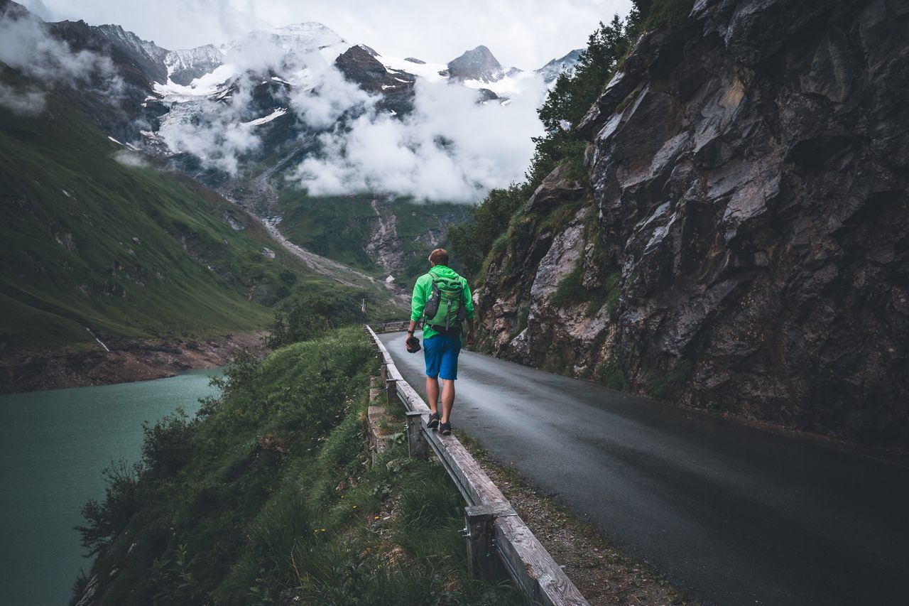 Moody sideways. Mountain Real People Rear View One Person Mountain Range Full Length Beauty In Nature Nature Leisure Activity Adventure Men Scenics Walking Backpack Lifestyles Day Hiking Casual Clothing Outdoors Rocky Mountains Austria Zell Am See