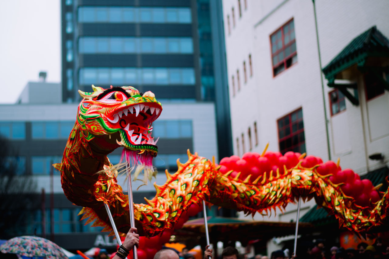 Dragon dance at the annual chinese new year festival. Architecture Birmingham Building Exterior Built Structure Chinese Dragon Chinese New Year City Cultures Day Dragon Dance Festival No People Outdoors Uk United Kingdom