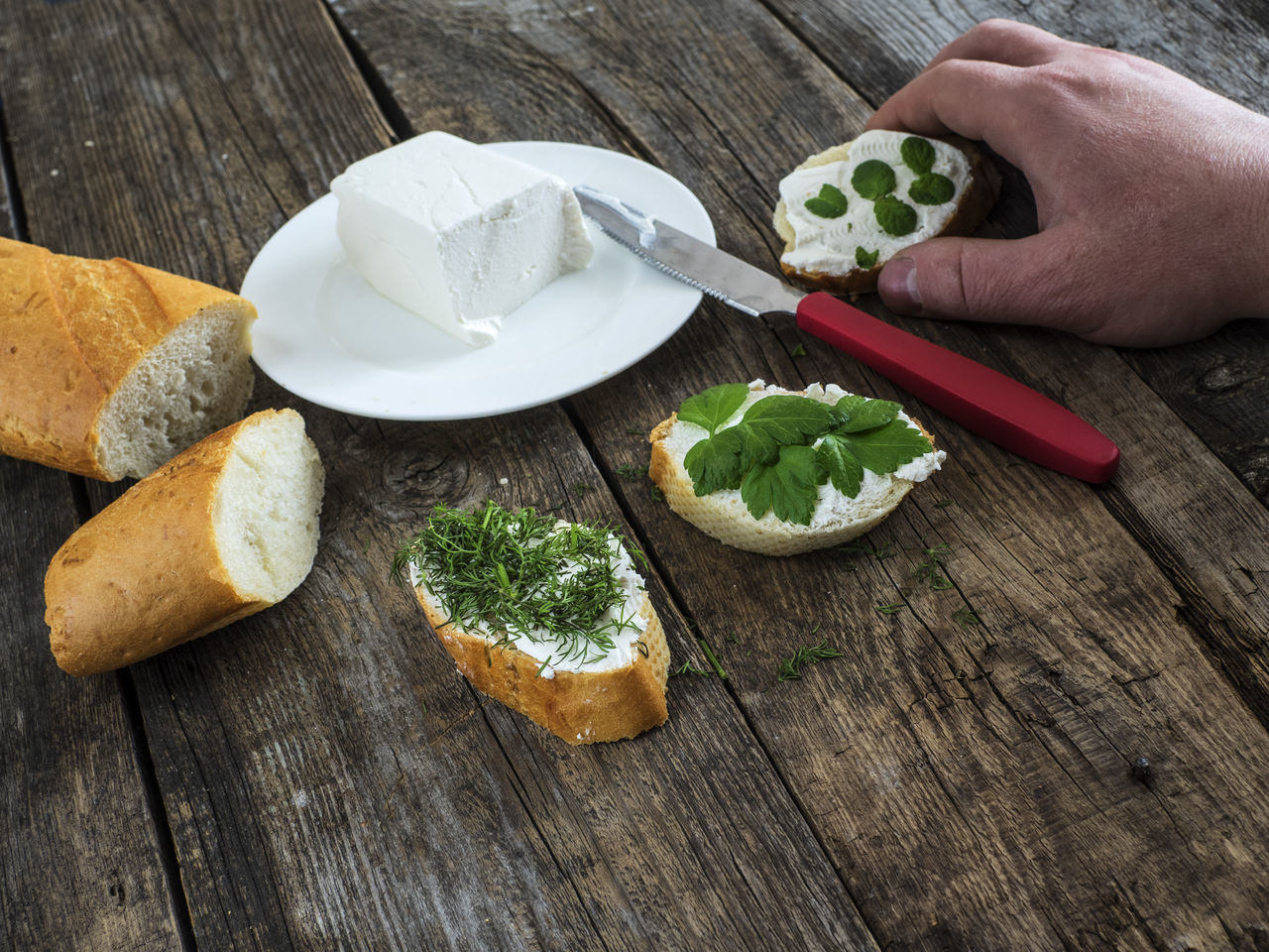 men's hand take bruschetta with feta cheese and chopped spicy herbs on an old wooden weathered table Adults Only Bread Bruschetta Cheese Chopped Close-up Feta Food Freshness Healthy Eating Healthy Lifestyle Herbs Human Body Part Human Hand Men Men's Old One Person One Woman Only Only Women Spicy Sprinkling Table Weathered Wooden