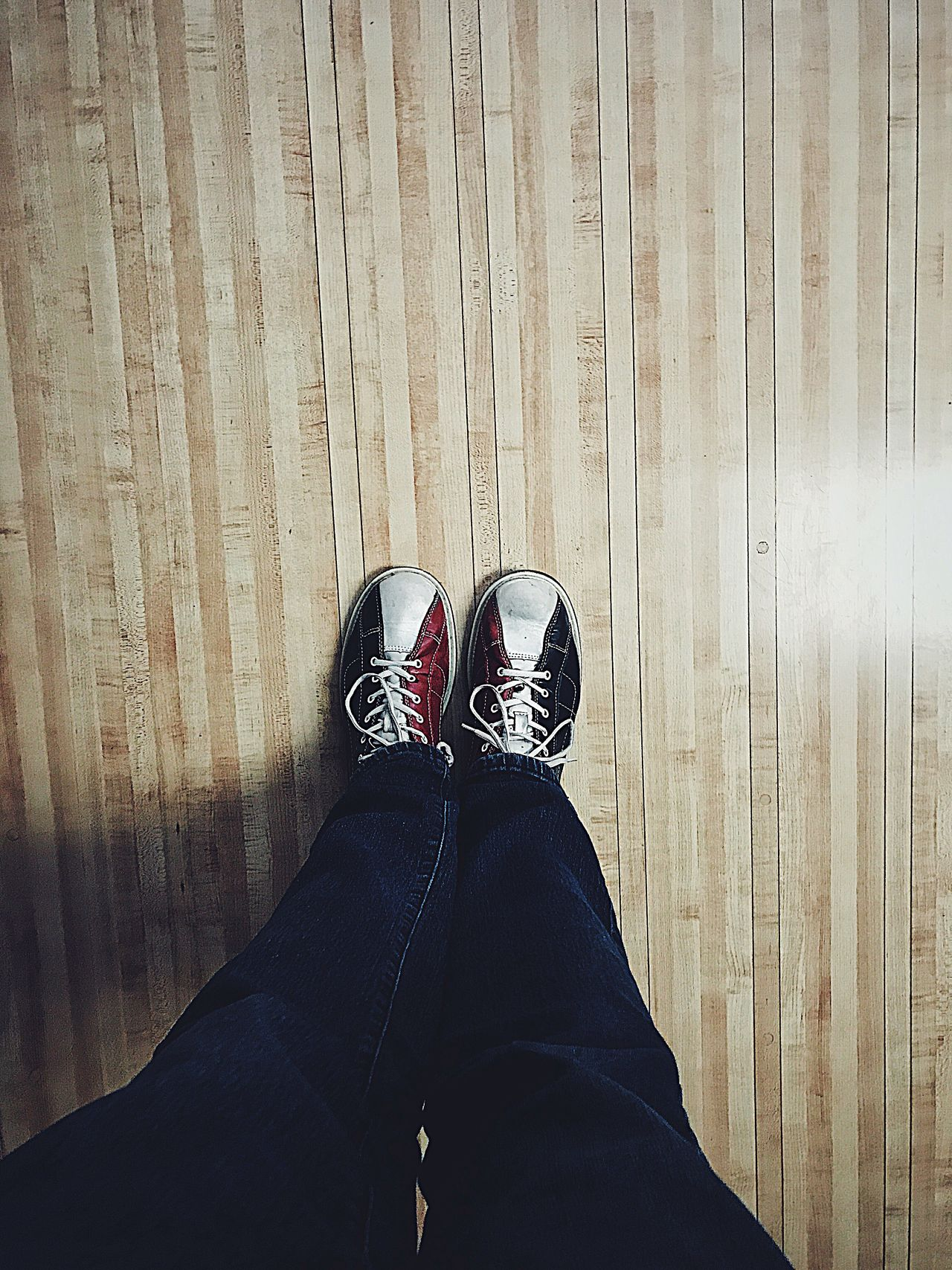 Bowling shoes Low Section Shoe Human Leg Personal Perspective Real People Human Body Part Indoors  One Person Standing Lifestyles Hardwood Floor Directly Above High Angle View Wooden Floor Men People Close-up Bowling