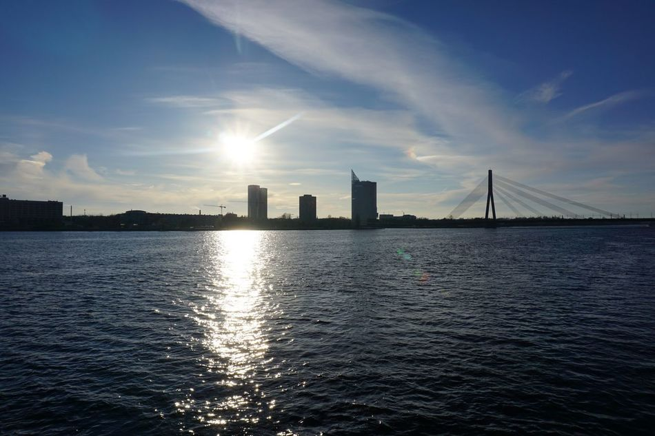 Architecture Bridge - Man Made Structure Building Exterior Built Structure City City Break Cloud - Sky Clouds And Sky Day Modern Nature No People Outdoors Reflections Riga River Sky Skyscraper Sun Sunlight Sunset Travel Destinations Urban Skyline Water Waterfront
