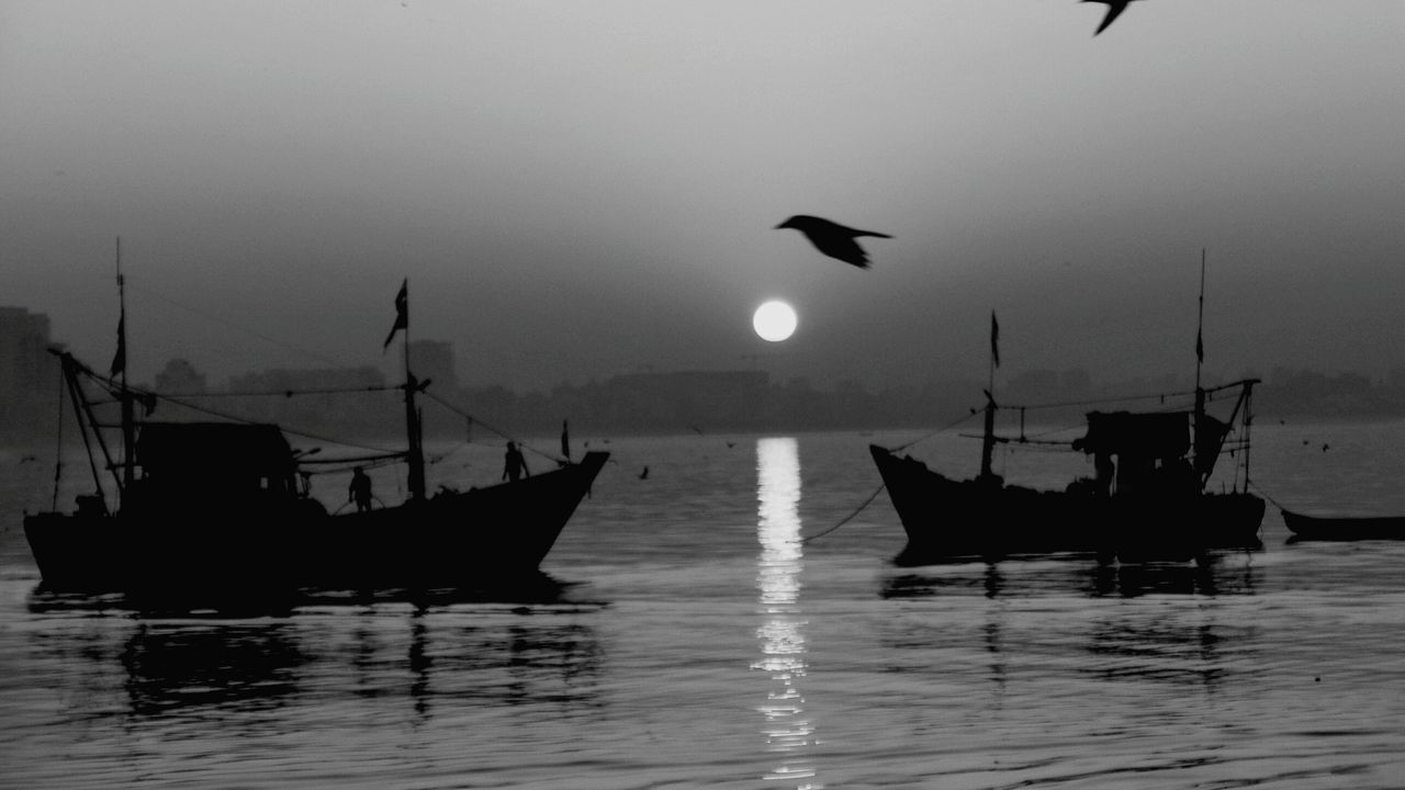 Nautical Vessel Fishing Sunset Transportation Reflection Travel Bird Silhouette Sea Water Travel Destinations Fisherman Outdoors Sailing Sky Uniqueness Photo Of The Day Photooftheday EyeEm Gallery EyeEm Best Shots Indianstories India EyeEm Nature Lover Landscape_Collection People