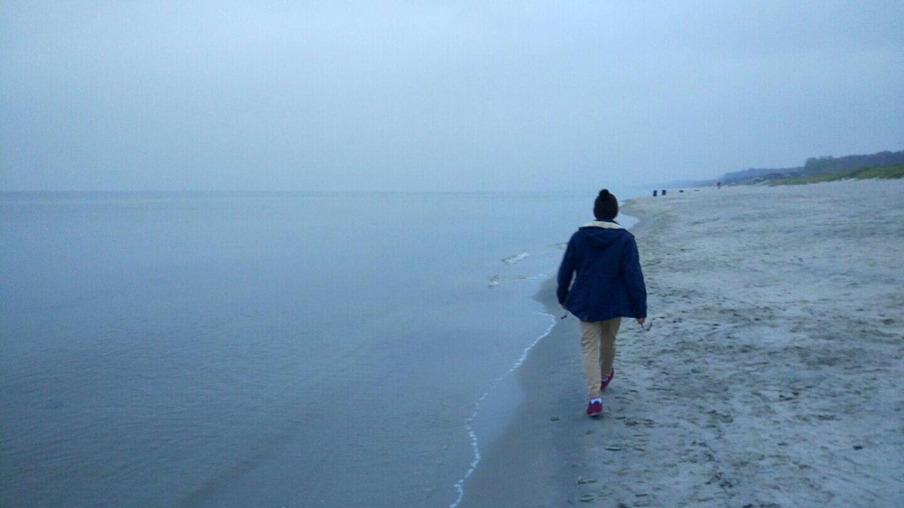 Walking Sea One Person Outdoors Horizon Over Water Beach Nature Beauty In Nature One Man Only Adults Only Day Rear View Water Sea And Sky Sea Life