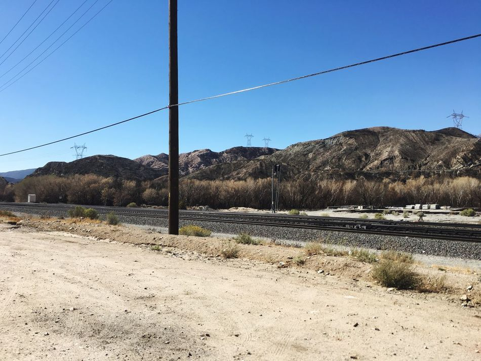 Landscape Railroad Track After The Fires Power Line  Back Roads Burnt Ground Mountain