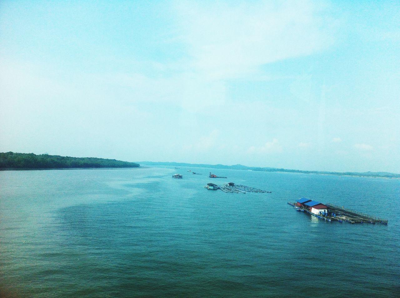 Fishing On The Bridge In Between Malaysia And Singapore
