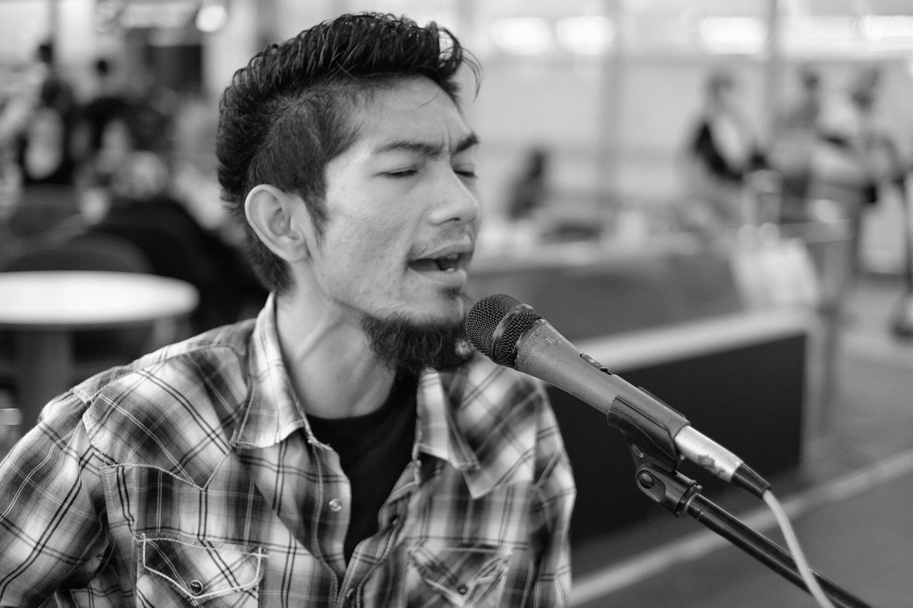 TakeoverMusic Young Adult Music One Young Man Only One Person Rock Music Streetphoto_bw Street Photography My Year My View Only Men Focus On Foreground Headshot Microphone Arts Culture And Entertainment Adults Only One Man Only Indoors  Real People Men Musician Close-up Adult People Singer  Day