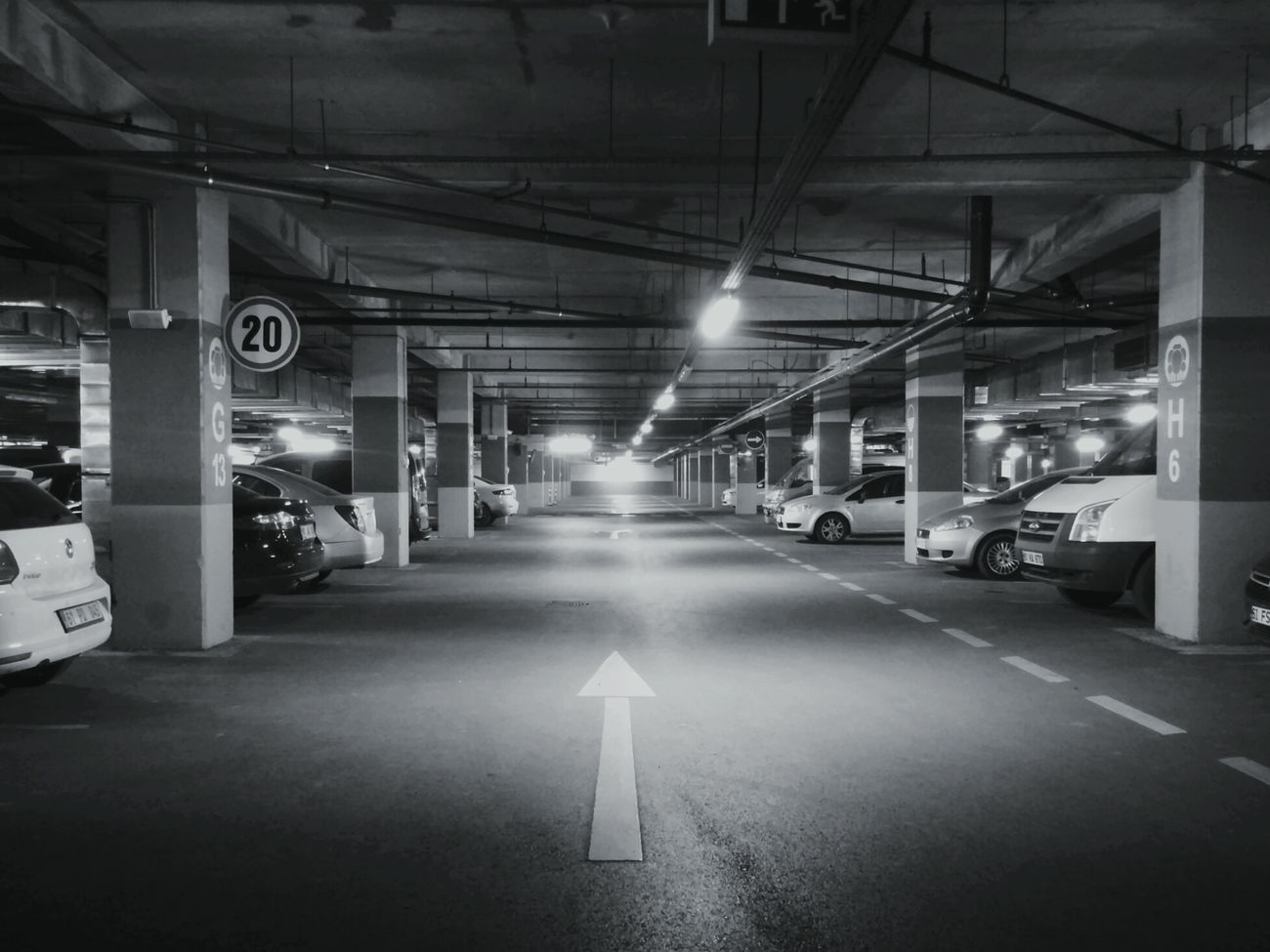 Parking Lot Industry Car Transportation Warehouse Parking Garage Store City No People Basement Road Sign Indoors  Neon Architecture Night Nikon Photography First Eyeem Photo Scenics Black Background Black White Asphalt Lines