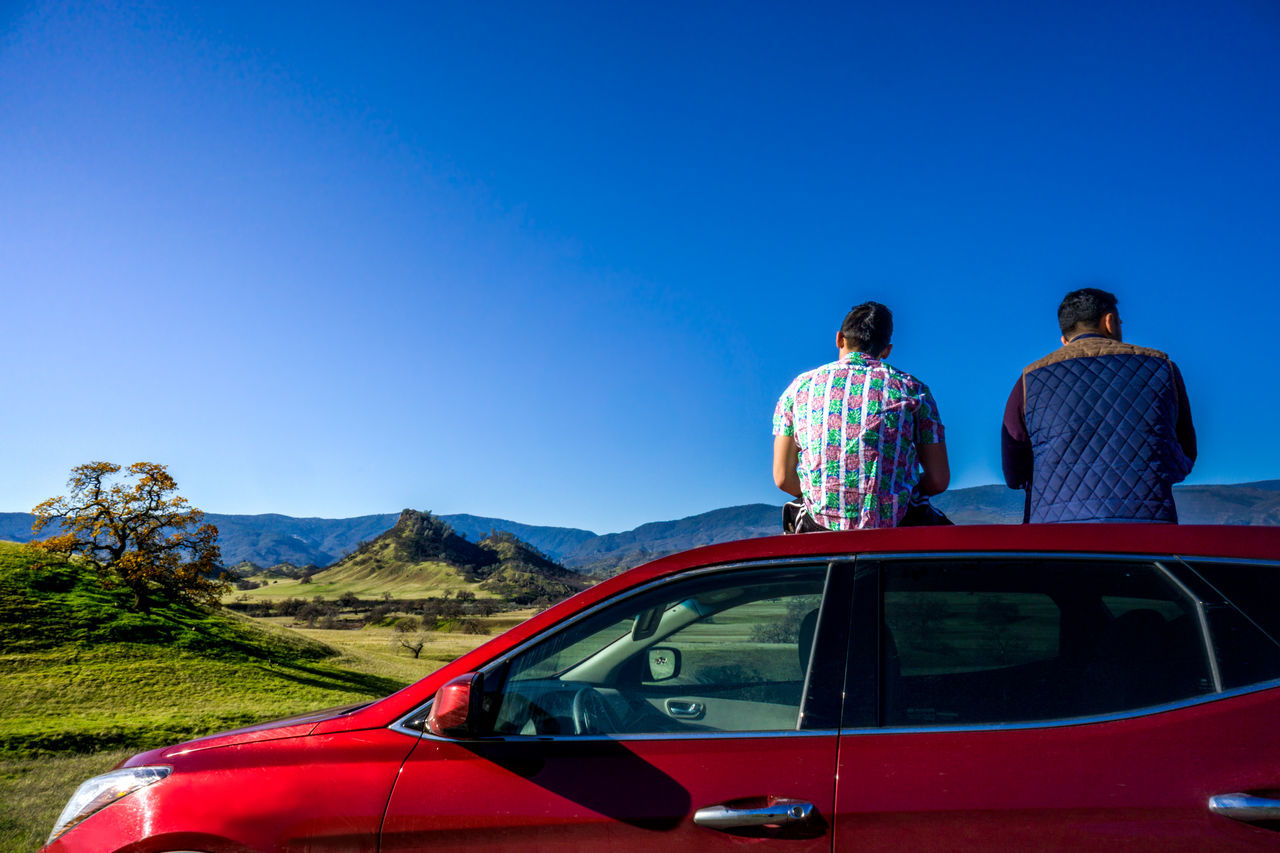 Adult Beauty In Nature Blue Bromance California Car Clear Sky Countryside Day Friends Journey Lone Tree Nature Offroad Outdoors Outdoors Photograpghy  People Rear View Roadtrip SUV Transportation Travel