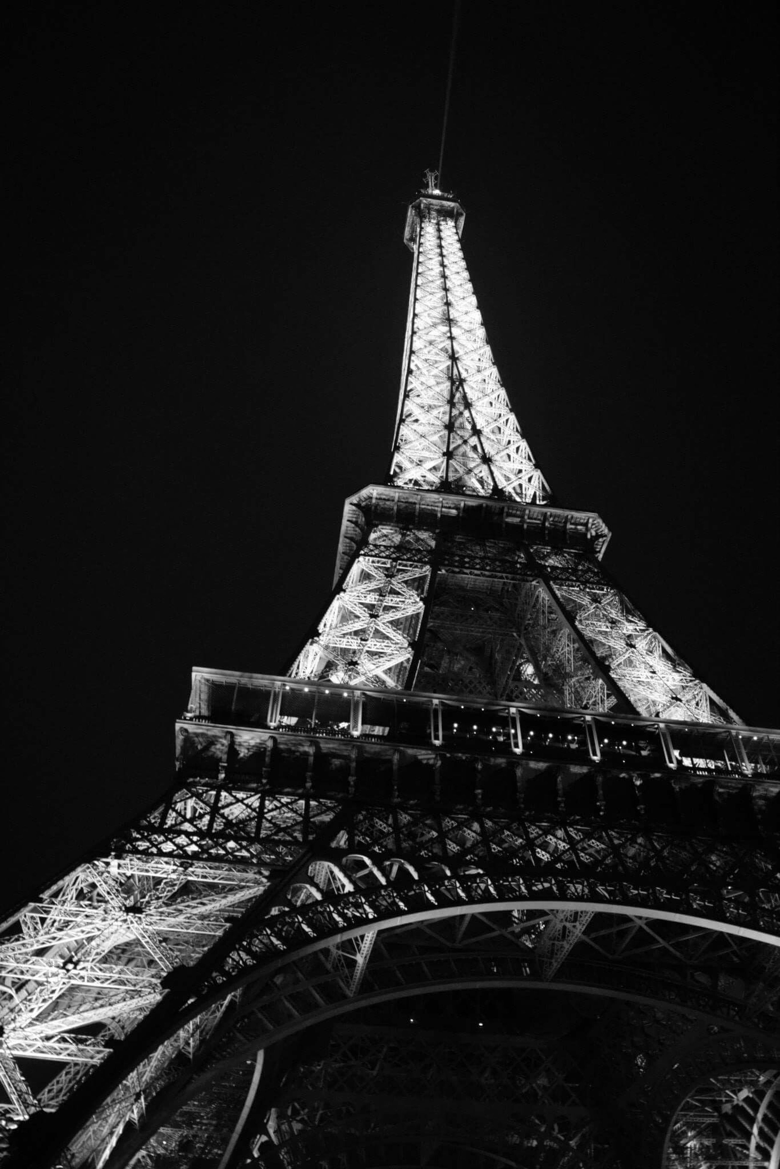 built structure, architecture, low angle view, clear sky, famous place, eiffel tower, travel destinations, building exterior, international landmark, travel, tower, metal, tourism, culture, copy space, night, history, capital cities, sky, outdoors