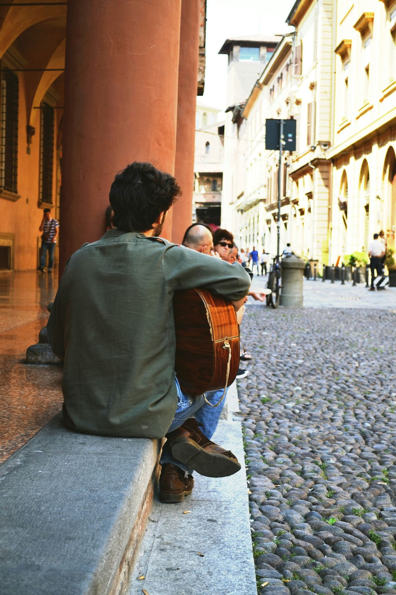 The Street Photographer - 2015 EyeEm Awards Streets Guitar Musician Italy Bologna Traveling City Life Roadtrip Streetphotography Greetings From Italy Up Close Street Photography Not An Ordinary Postcard