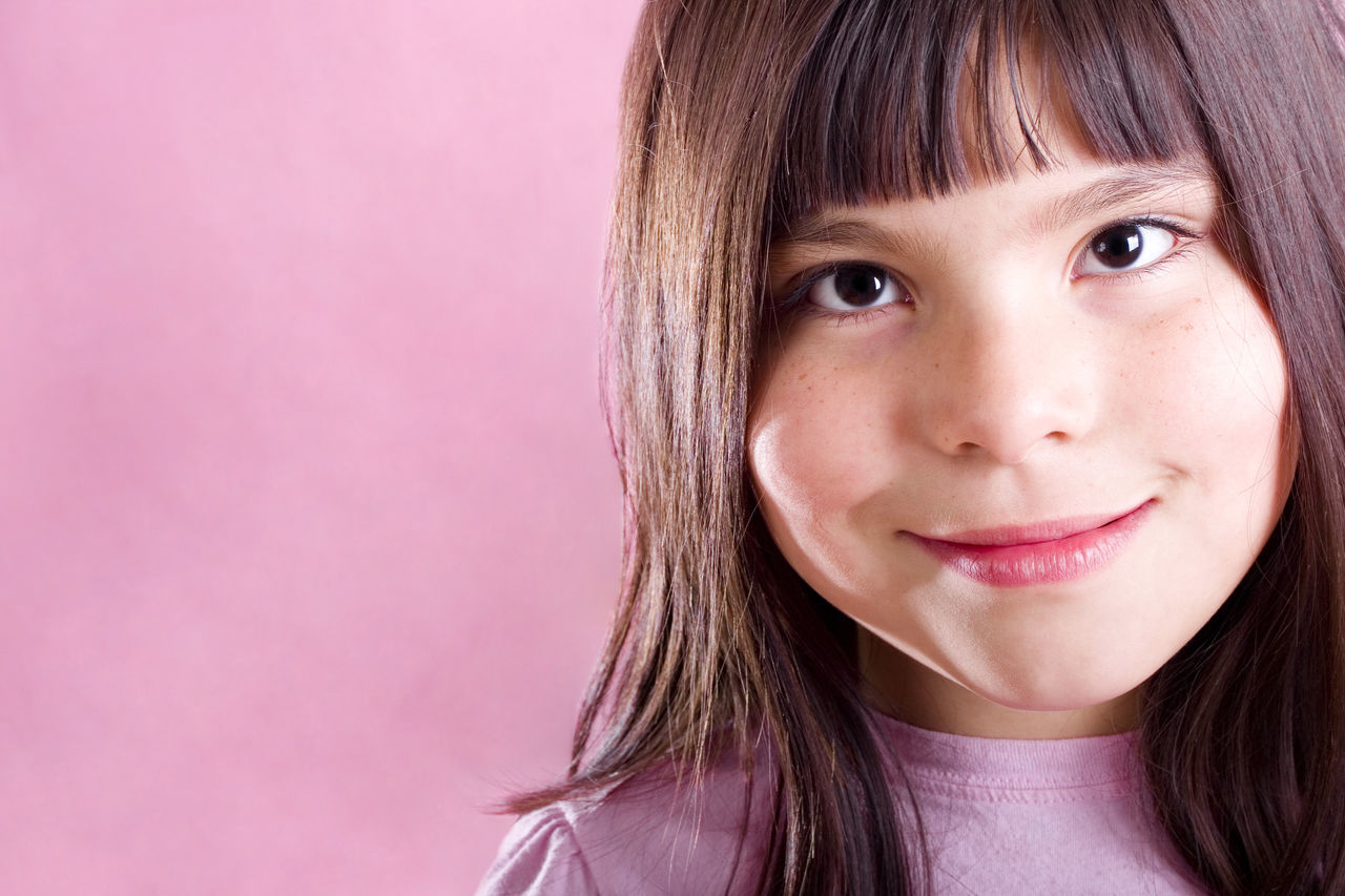 Cute girl Smiling Bangs Biracial Child Childhood Children Children Only Copy Space Expression Expressive Girl Happy Happy People Headshot Human Face Kid Kids Being Kids Looking At Camera Mixed Race One Person Pink Background Pink Color Portrait Smiling