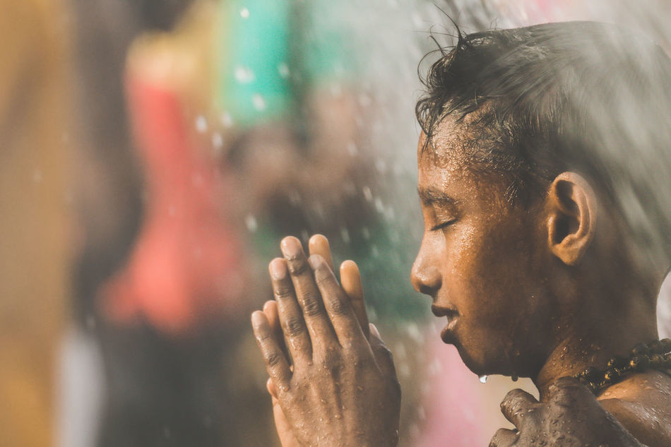 A Hindu devotee takes a shower during Thaipusam festival in Batu Caves, Malaysia to fulfil their vows and offer thanks to the deities. Batu Caves -Malaysia Close-up Day Headshot Hindu Culture Hindu Gods Hinduism Indoors  Men One Person People Praying Real People Shower Thaipusam Young Adult