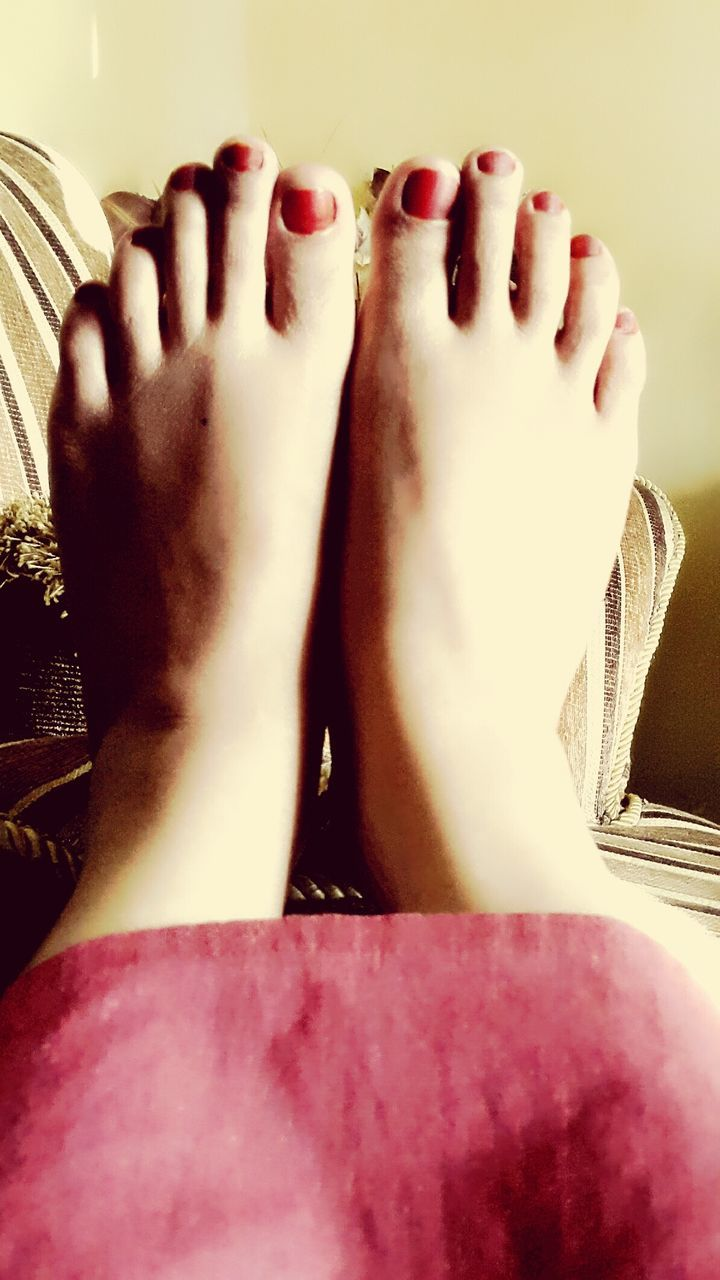 real people, barefoot, one person, human foot, low section, human body part, indoors, human leg, lifestyles, women, relaxation, leisure activity, nail polish, close-up, day, people