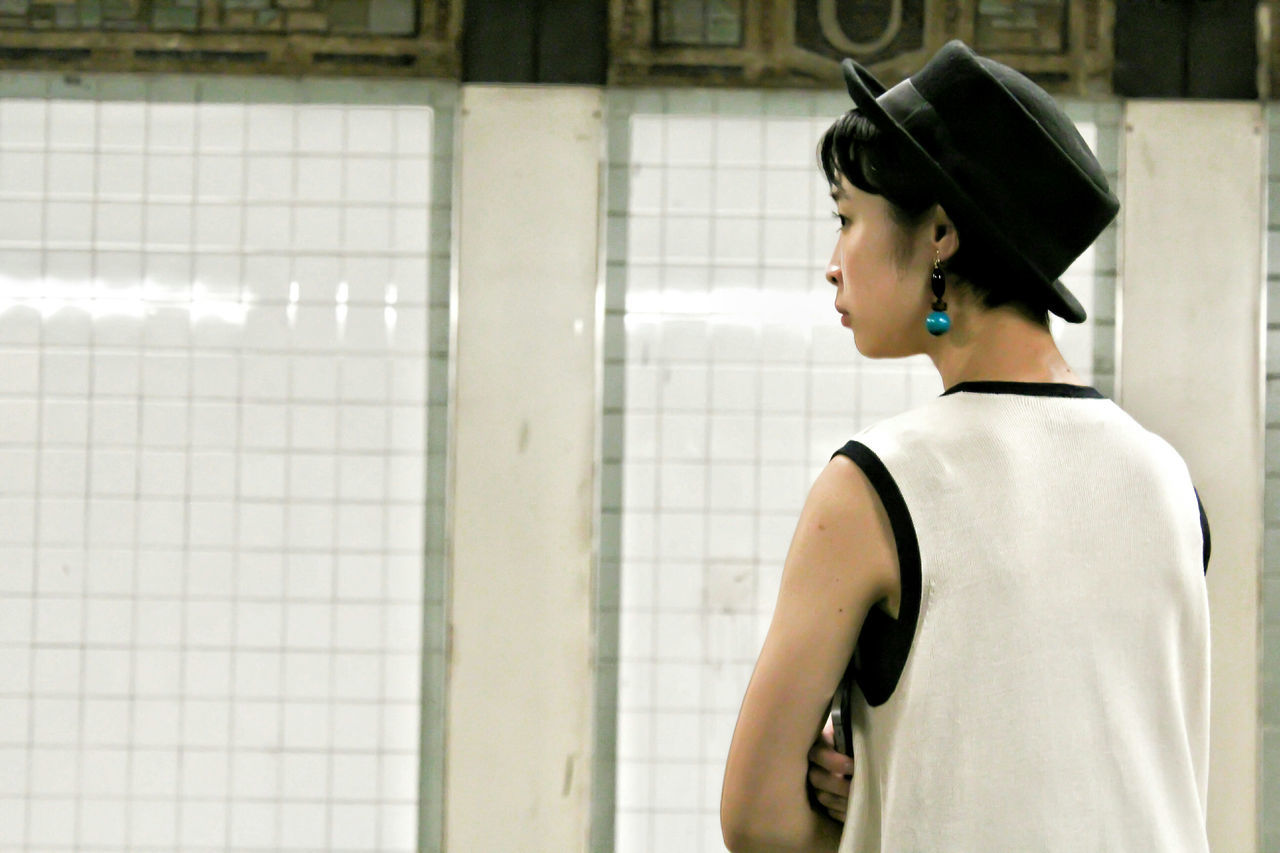 it is midnight in New York City - A girl with a blue pearl earring Midnight casual clothing Subway Station Young Adult Standing Portrait Blue Pearl Girl Streetphotography Hat Asian Girl Gistilish Glamour Casual Clothing Glam Glamour Girl Glamour Glamourous Glamour Fashion Beauty Photographer Subway Portraits New York New York City Newyork Subway Subwayphotography
