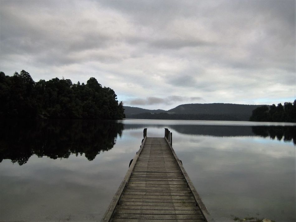 Beauty In Nature Boardwalk Cloud Landscapes With WhiteWall Glass Idyllic Jetty Lake Mirror; Nature New Zealand New Zealand Beauty New Zealand Landscape Pier Railing Reflection Scenics Sky The Way Forward Tranquil Scene Tranquility Water Wood - Material