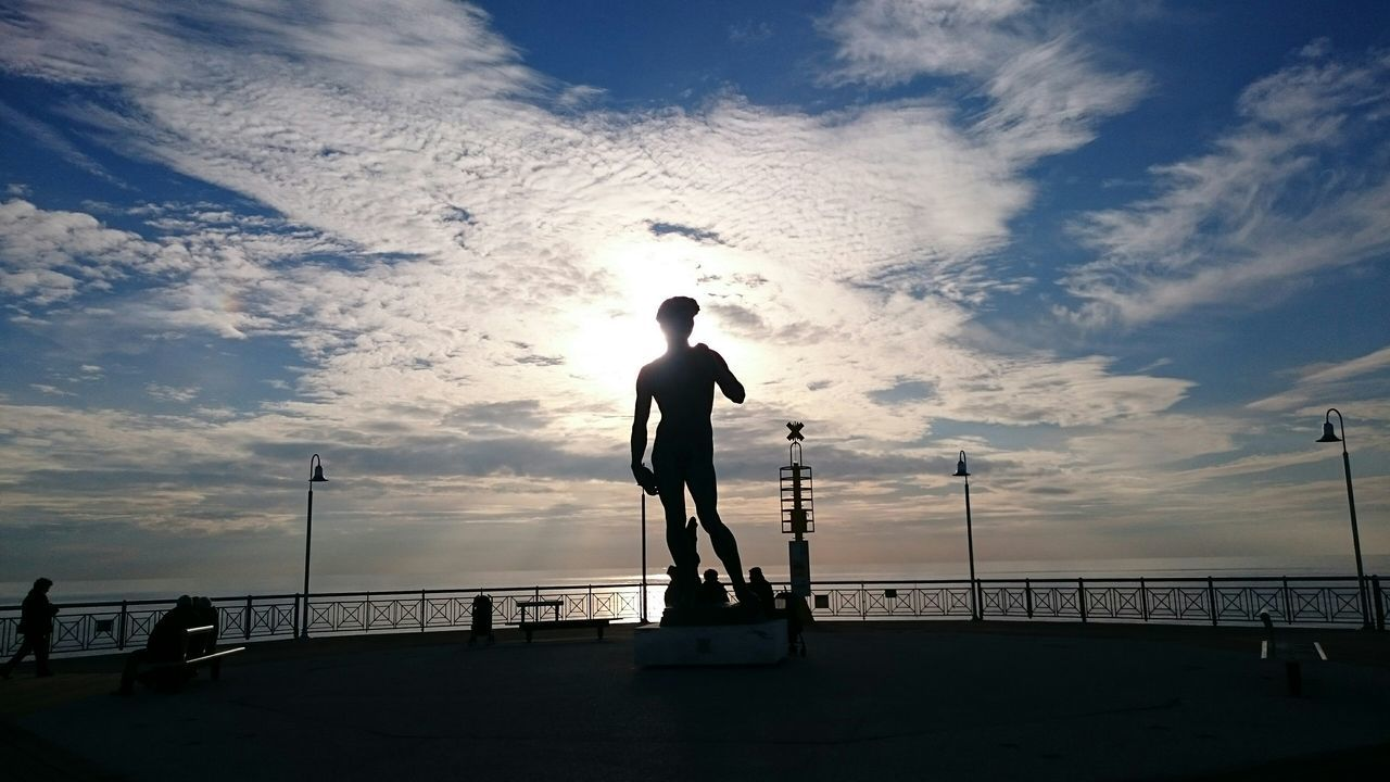 Silhouette Statue By Sea Against Sky