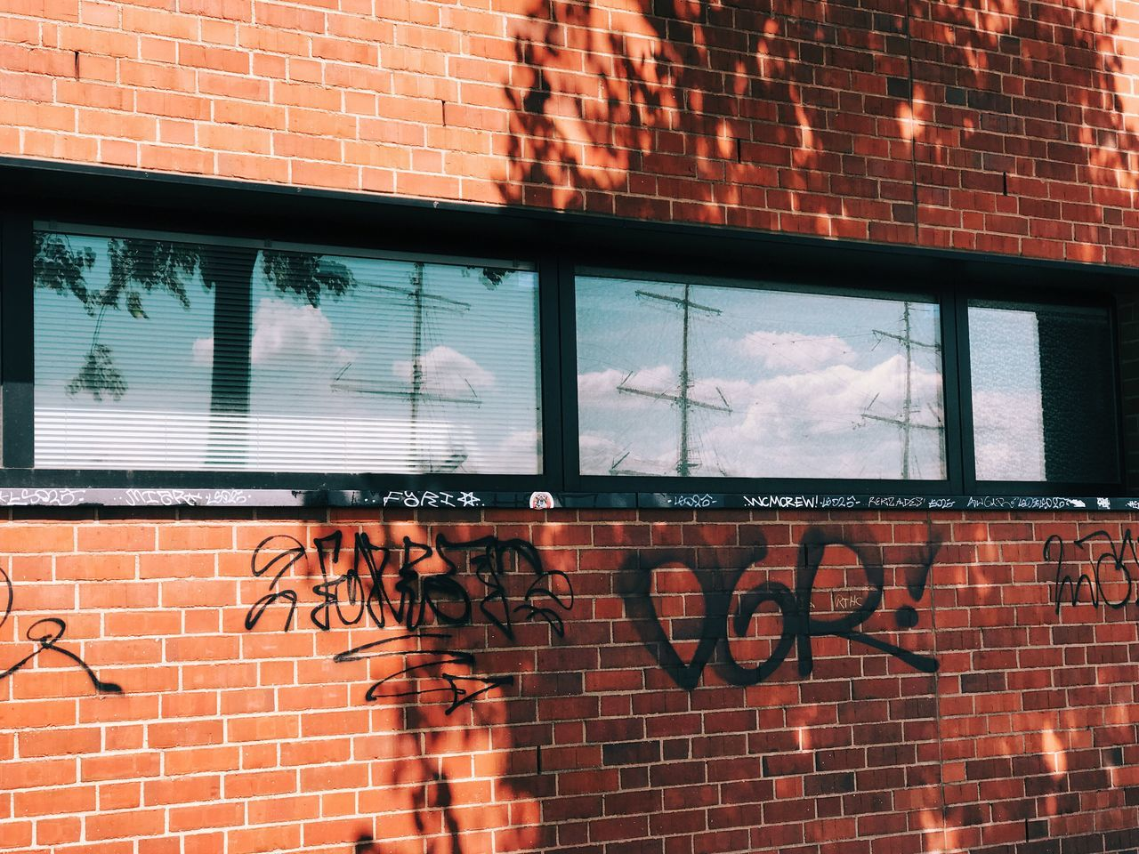 Brick Wall Brick Window Text Architecture Day Built Structure Building Exterior Outdoors Communication No People Low Angle View City Reflection Windows Graffiti Tags
