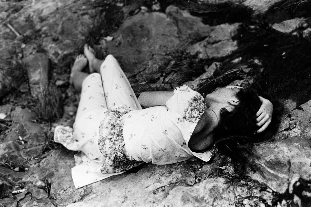 lying down, young adult, sleeping, one person, young women, one woman only, one young woman only, eyes closed, only women, adults only, lying on back, adult, full length, people, fashion, outdoors, smiling, day, beautiful woman, happiness