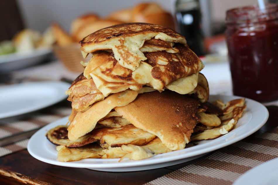 Homemade pancakes on breakfast table Breakfast Close-up Day Deep Fried  Fast Food Focus On Foreground Food Food And Drink Freshness Indoors  Indulgence Marmalade Marmelade No People Pancake Pancakes Plate Ready-to-eat Serving Size Table Unhealthy Eating Weekend