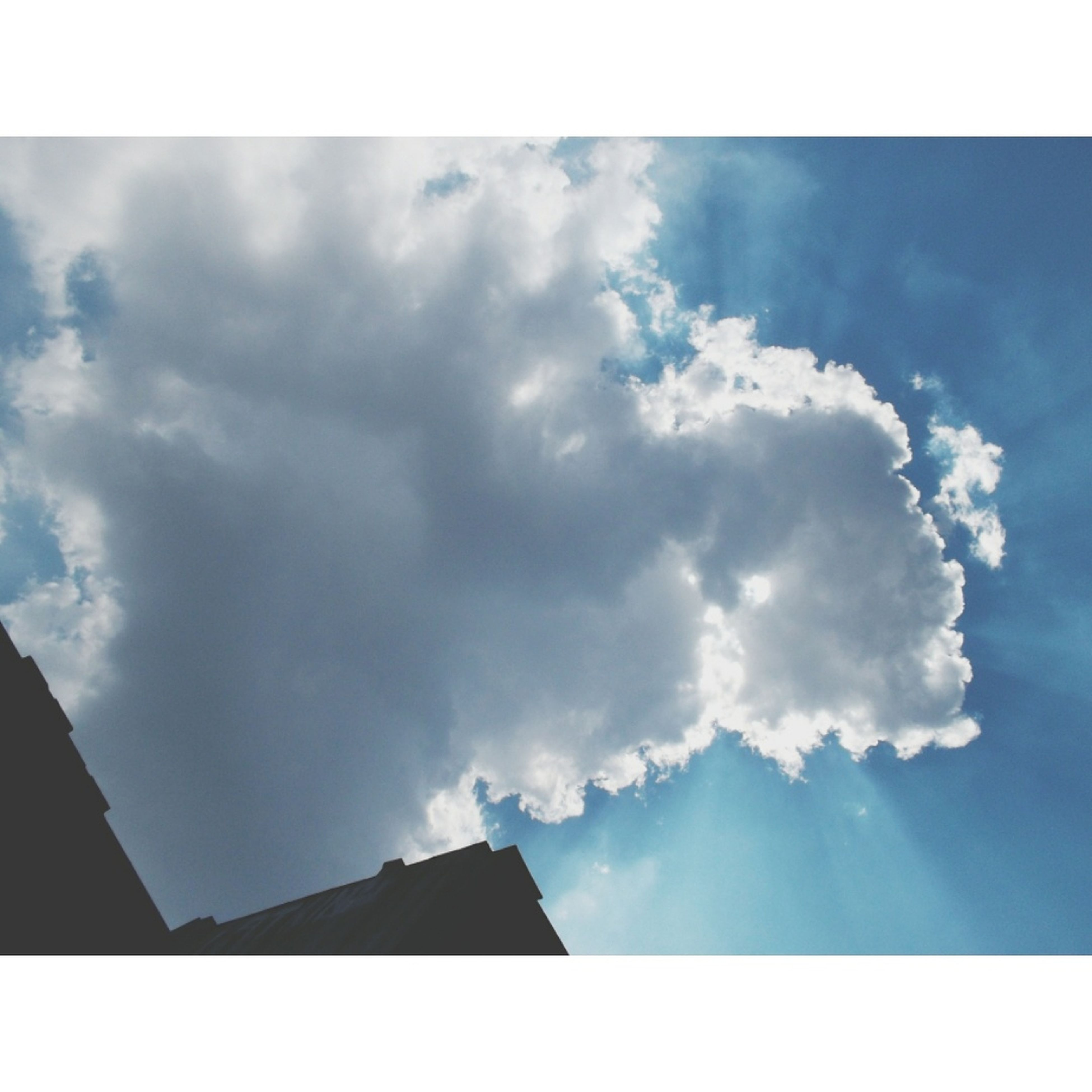 transfer print, sky, auto post production filter, cloud - sky, low angle view, beauty in nature, cloud, scenics, nature, cloudy, blue, silhouette, tranquility, tranquil scene, outdoors, sunlight, no people, day, idyllic, sunbeam