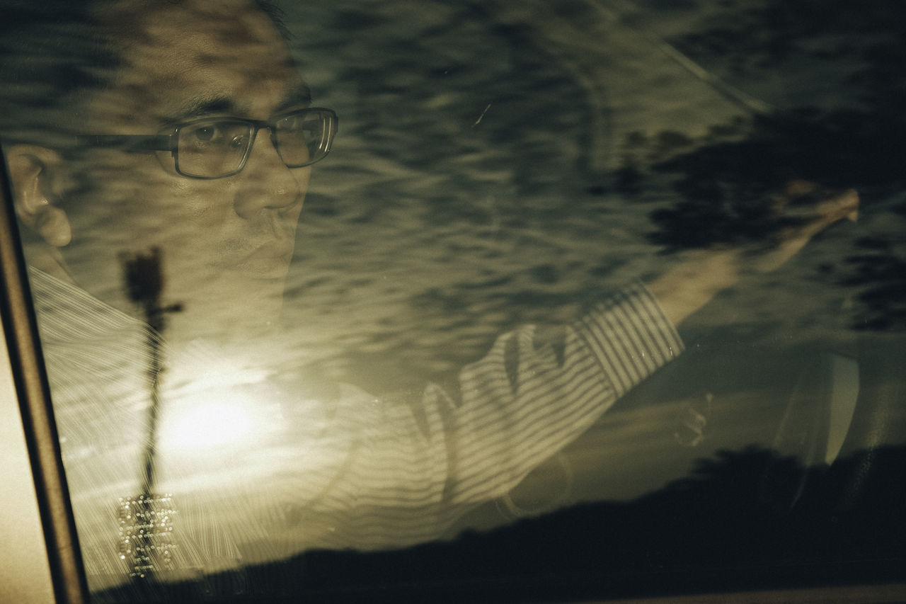 Driver behind a car windscreen with a sun reflection Automobile BYOPaper! Close-up Dashboard Day Driving Eyeglasses  Glasses Indoors  One Person People Portrait Real People Reflection Sunrise Sunset The Portraitist - 2017 EyeEm Awards Windows Windscreen Young Adult