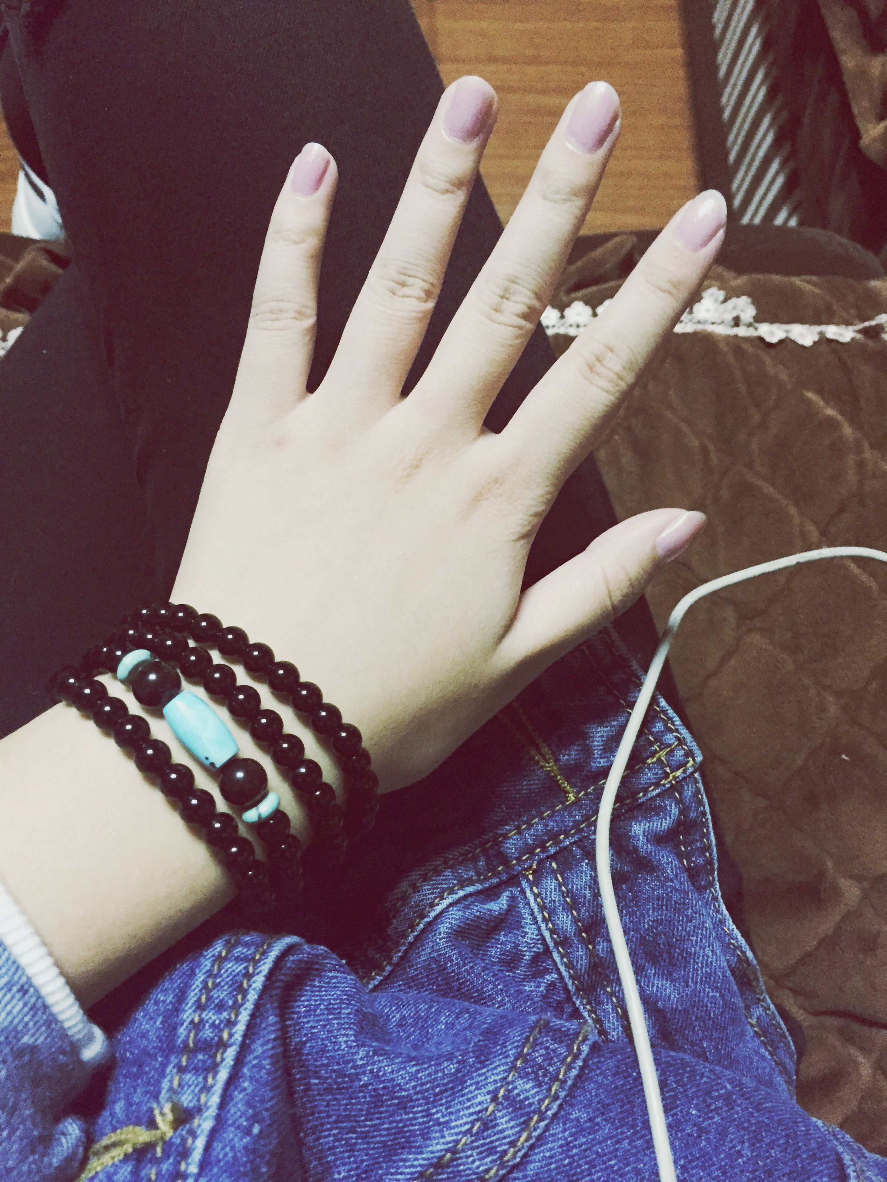 person, part of, lifestyles, close-up, indoors, human limb, leisure activity, bracelet, individuality, casual clothing, youth culture, personal perspective, fashionable, limb, human finger, focus on foreground, one woman only